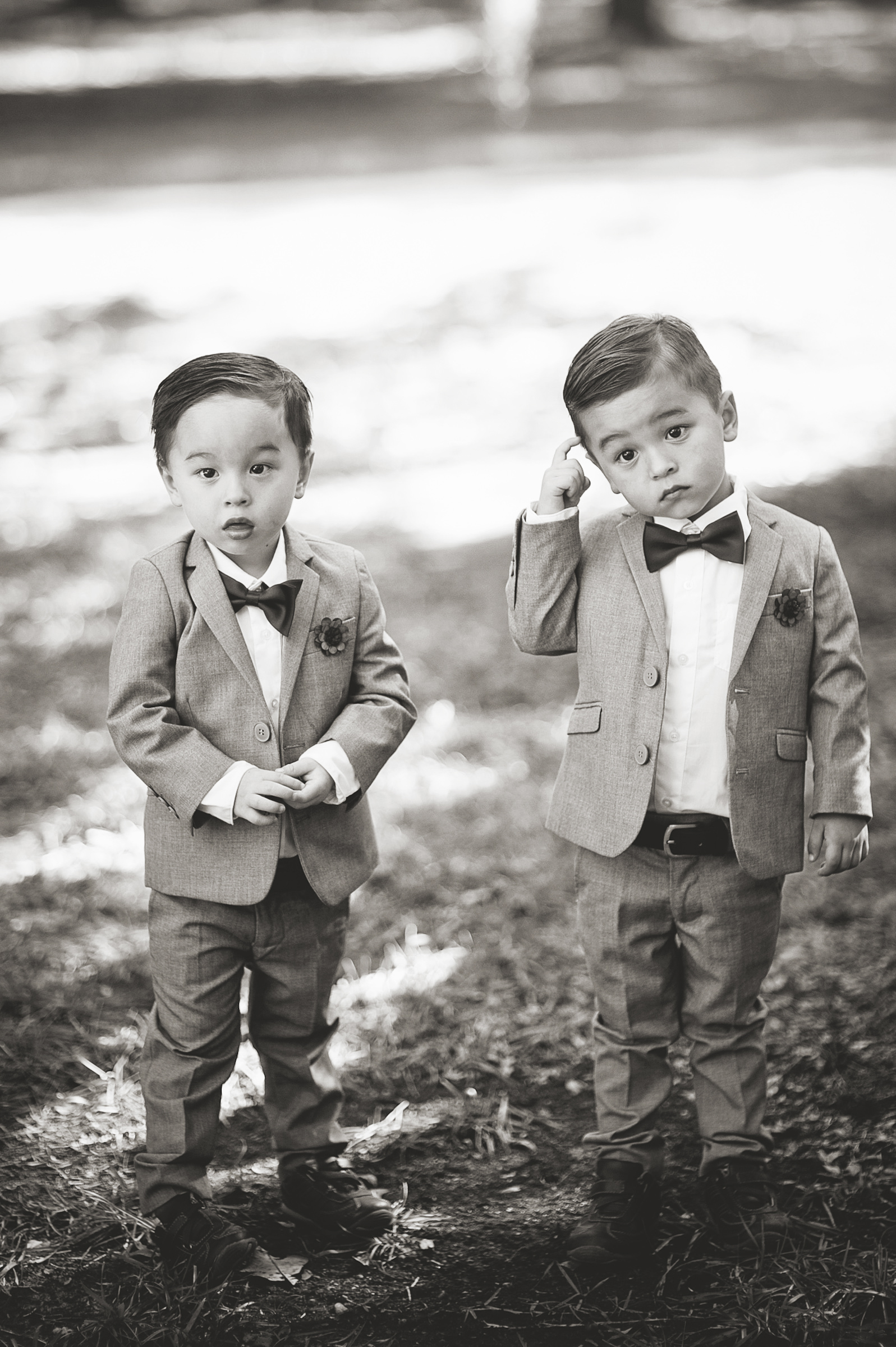 Two little boys in light linen suits and bowties - photo by Richard Israel