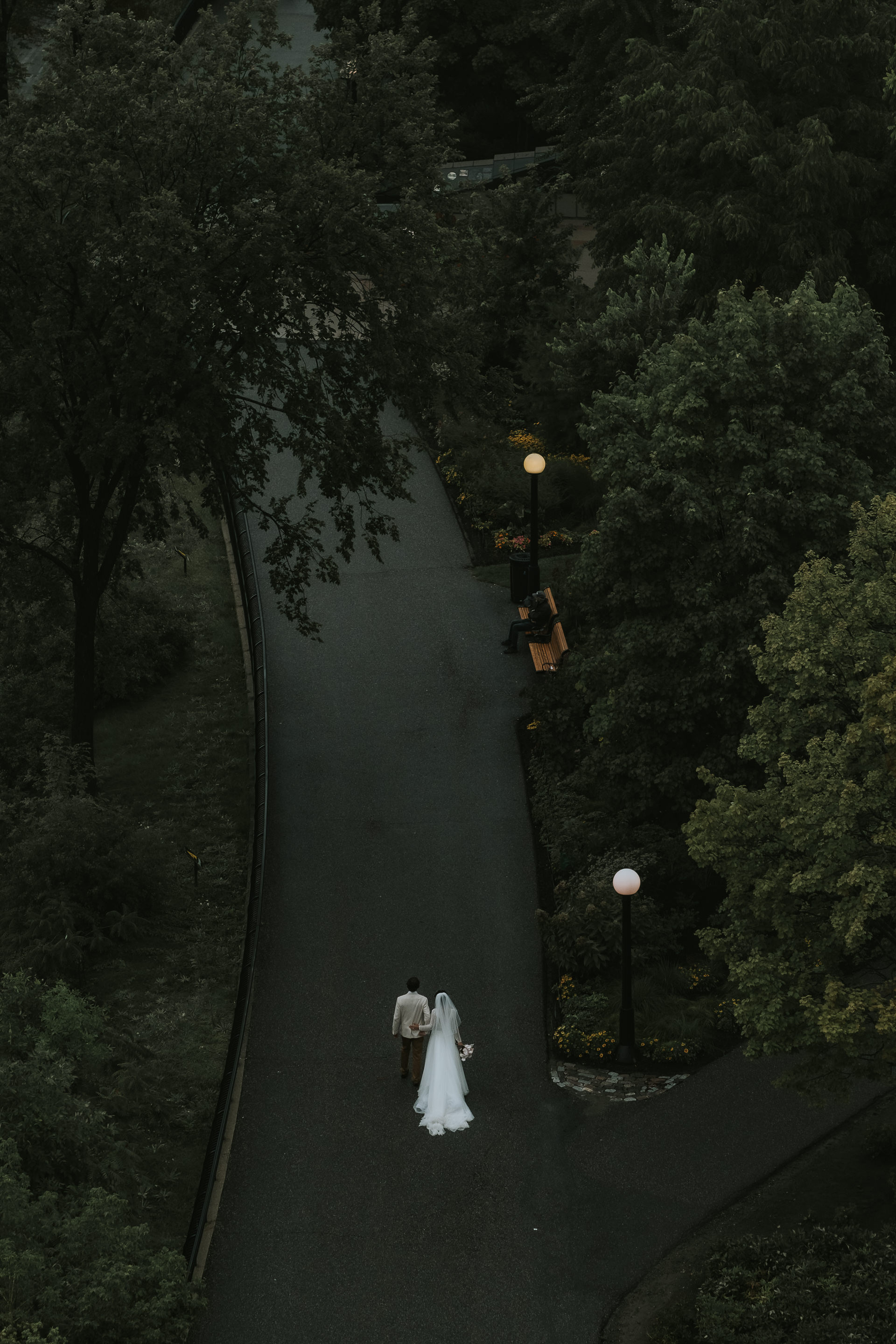 Aerial view of bride and groom on evening walk photographed by Joel & Justyna - Ottawa wedding photographers