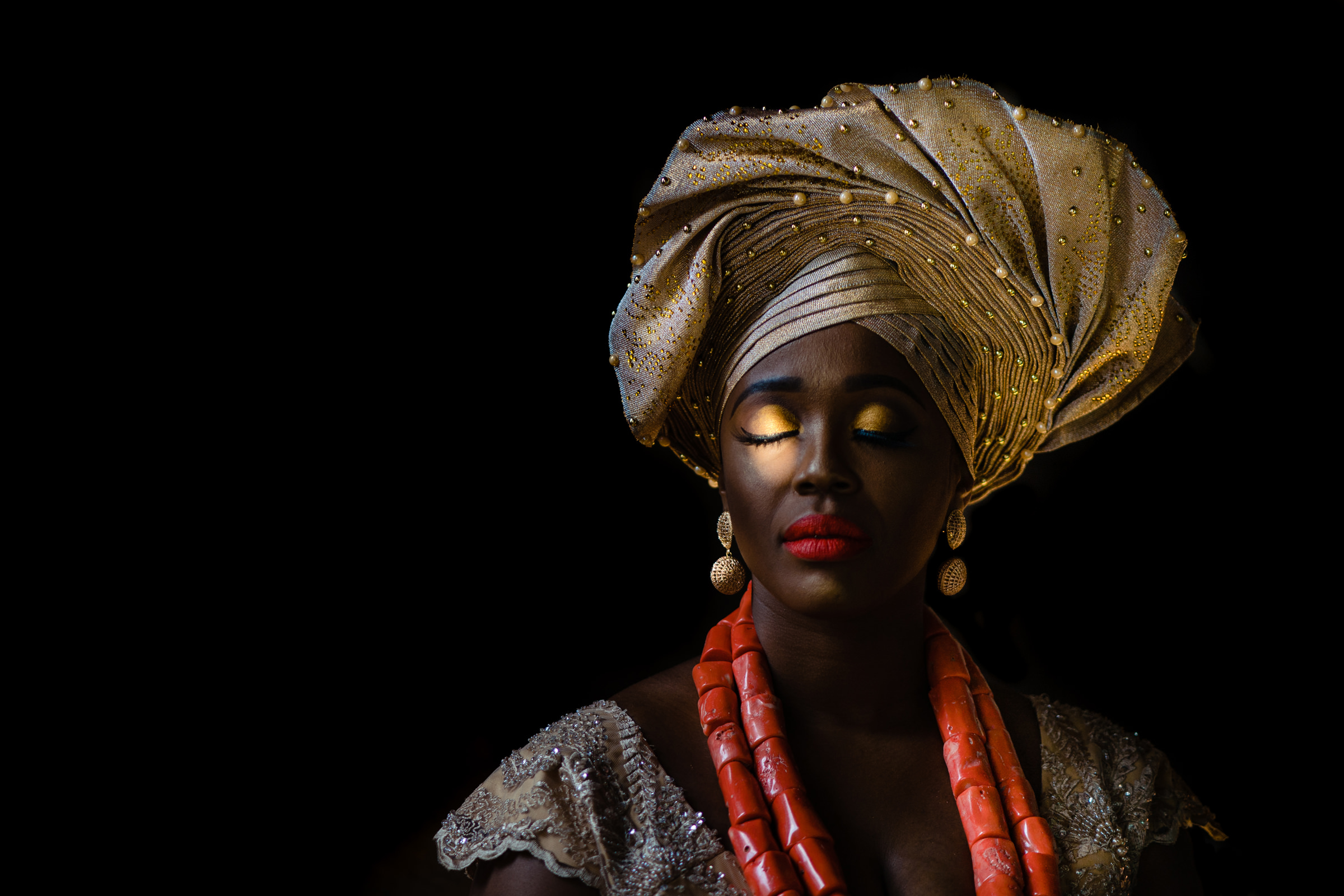 Bride wearing gold African headdress with gold eyeshadow and bright red lips - photo by Vinson Images - Arkansas