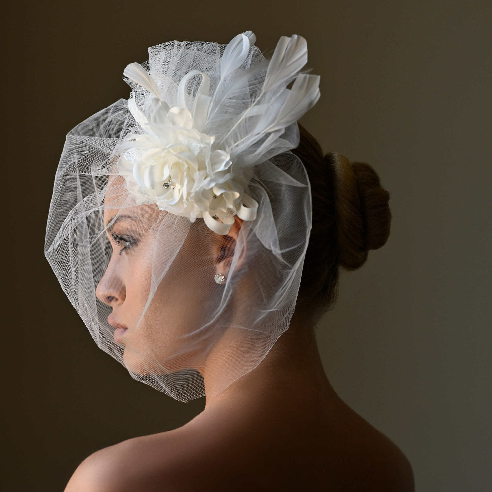 Bride wearing birdcage veil with ribbon bows - photo by Jerry Ghionis - Las Vegas
