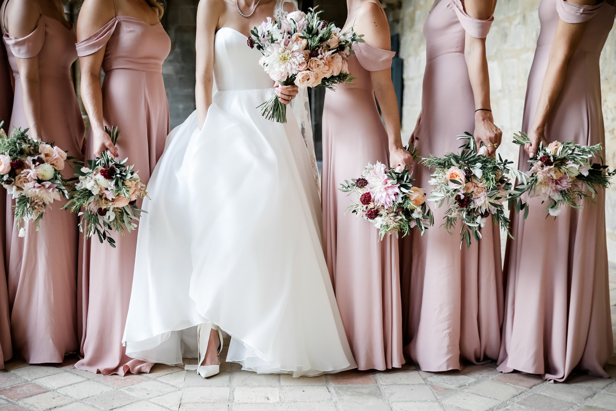 Pink crepe drop-shoulder bridesmaids dresses and bouquets - photo by Julien Laurent Georges
