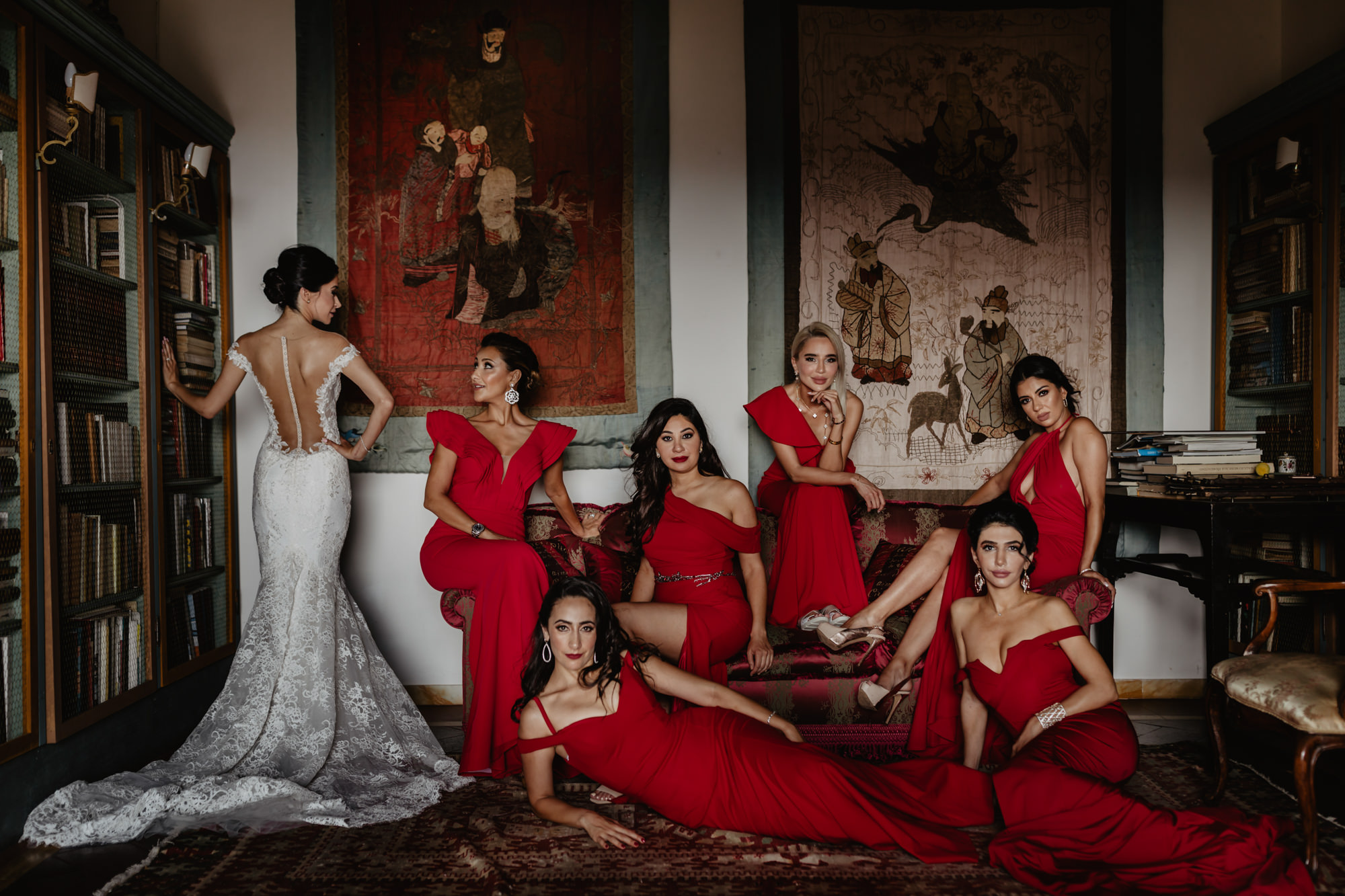 Bridesmaids in sultry, red crepe gowns photographed by David Bastianoni - Italy