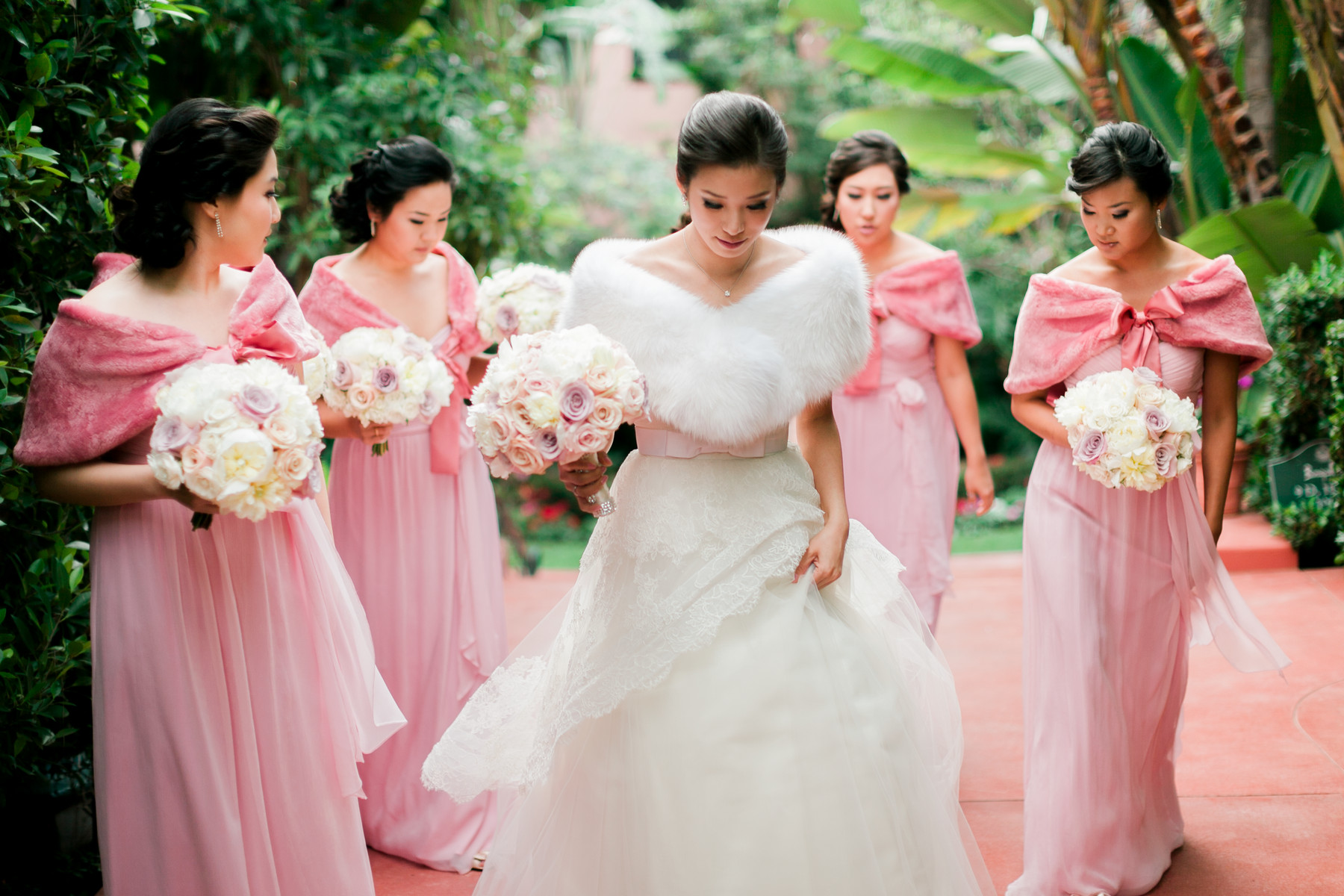 Bridal party wearing pink faux-wraps - photo by John and Joseph