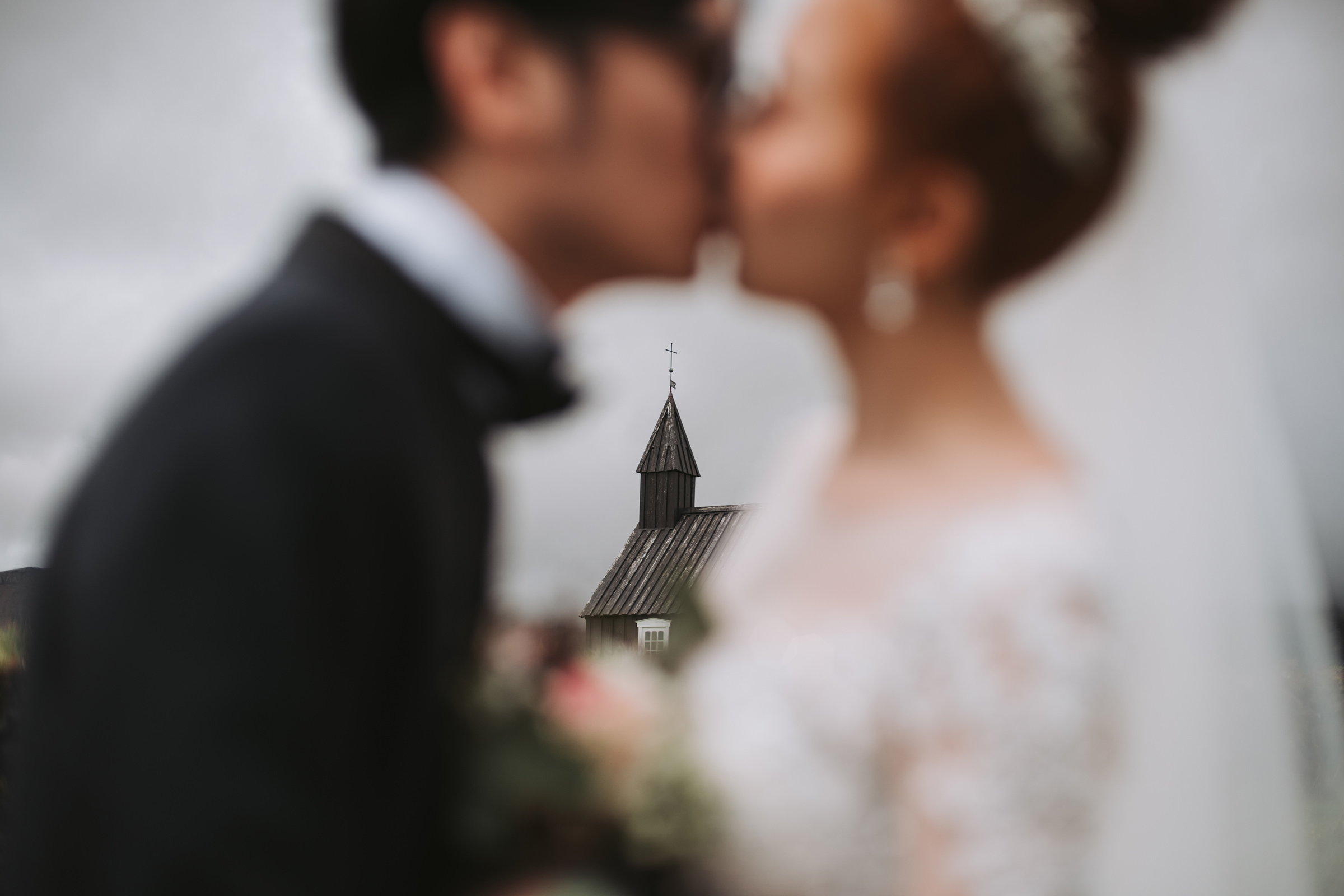 Bride and groom in front of church with faces out of focus - photo by MunKeat Studio - Malaysia