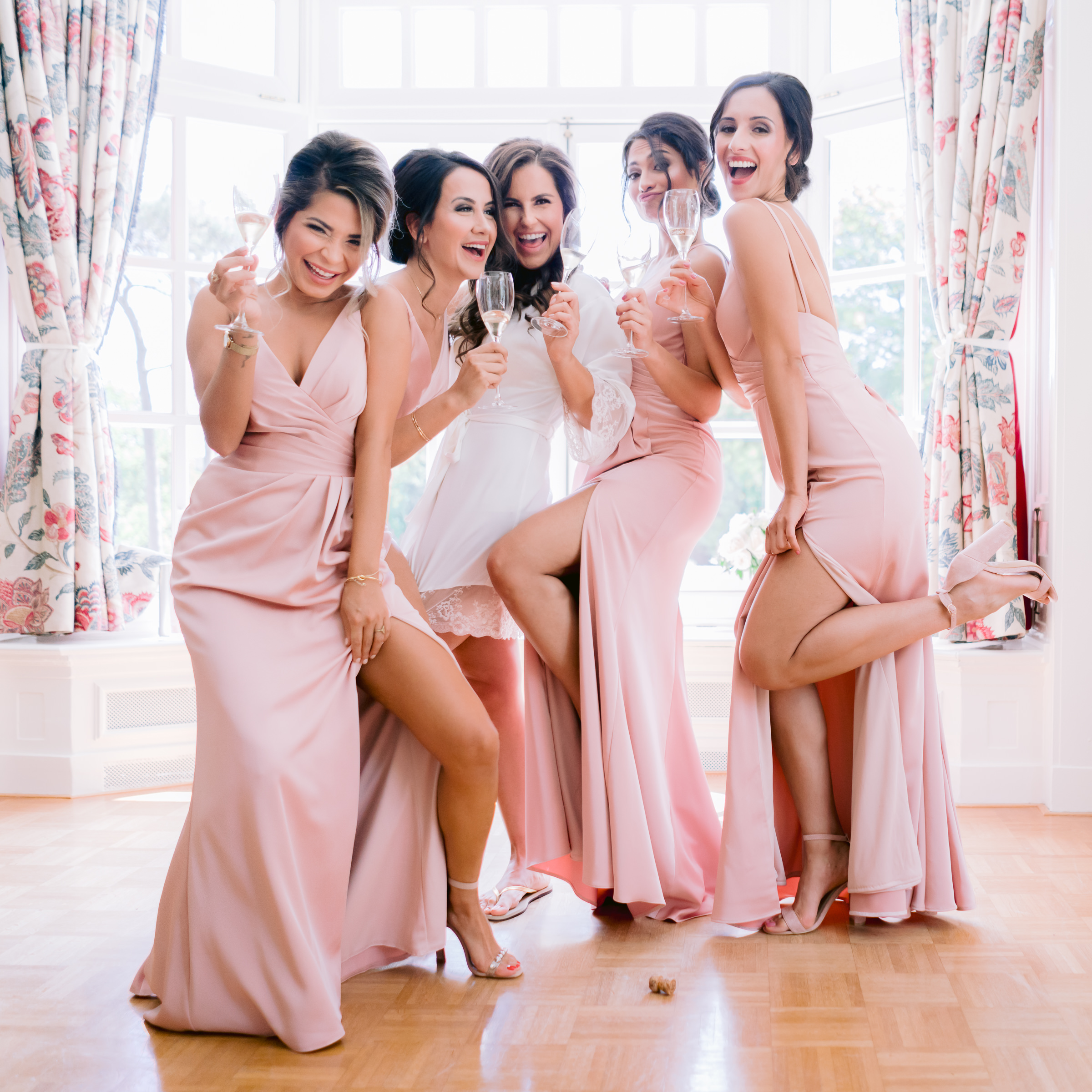 Bridal party wearing pink crepe spaghetti-strap wrap dresses  - photo by Peter van der Lingen