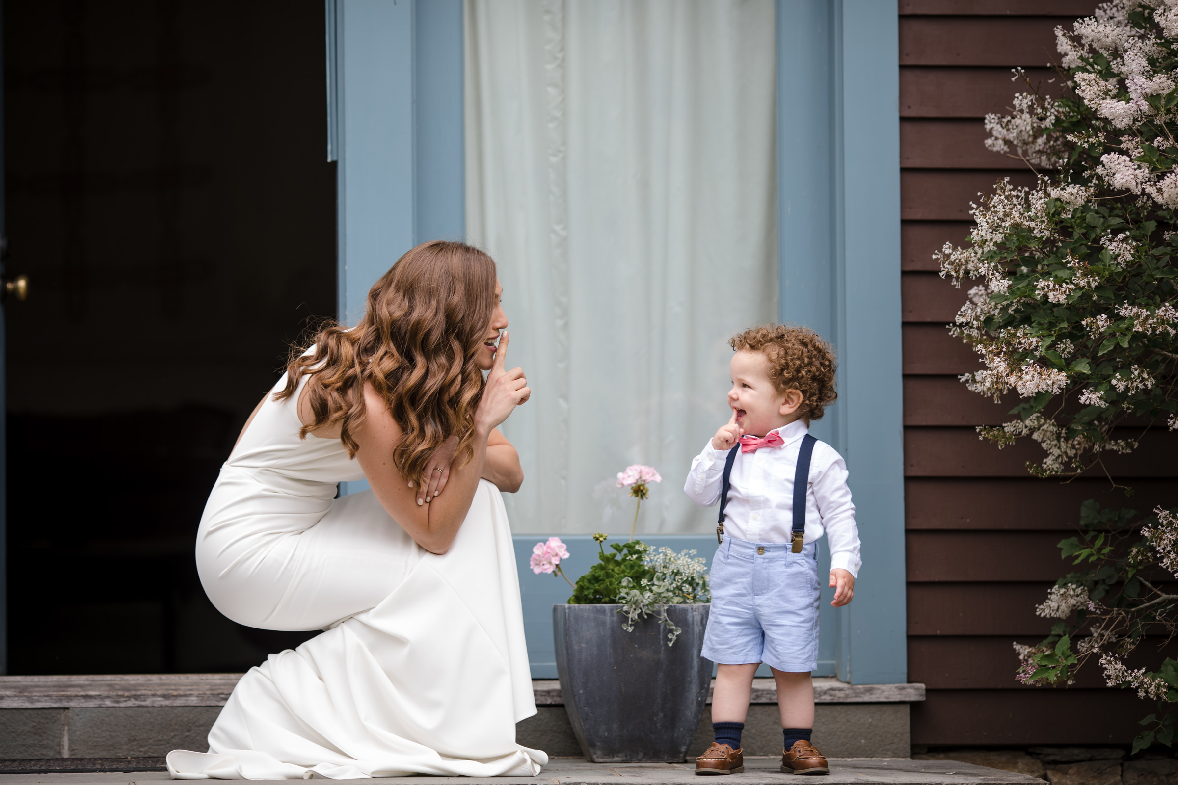 Toddler wearing red bow tie, light blue shorts and suspenders - photo by Susan Stripling