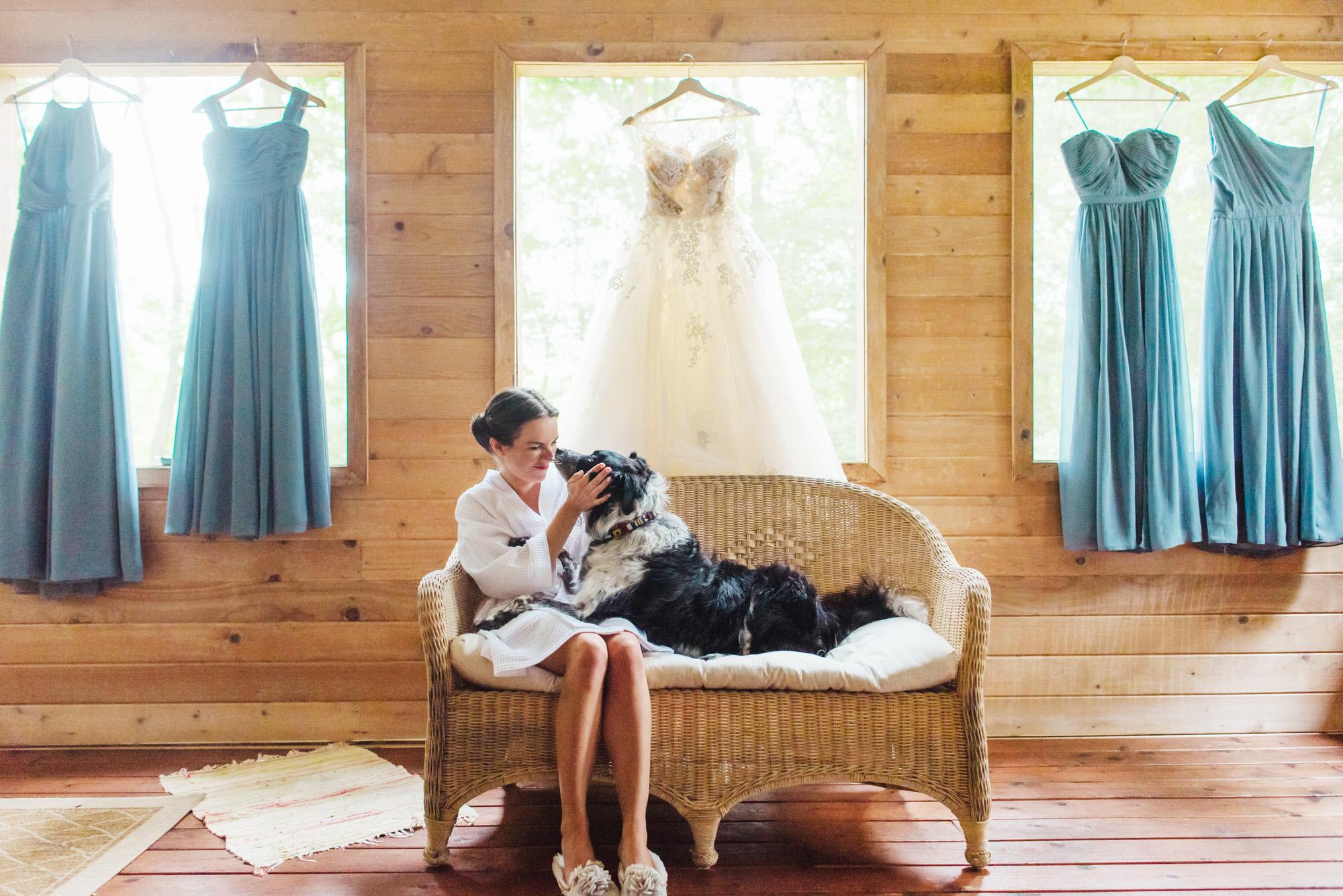 bride-and-dog-against-dresses-by-ken-pak-washington-dc-photographer