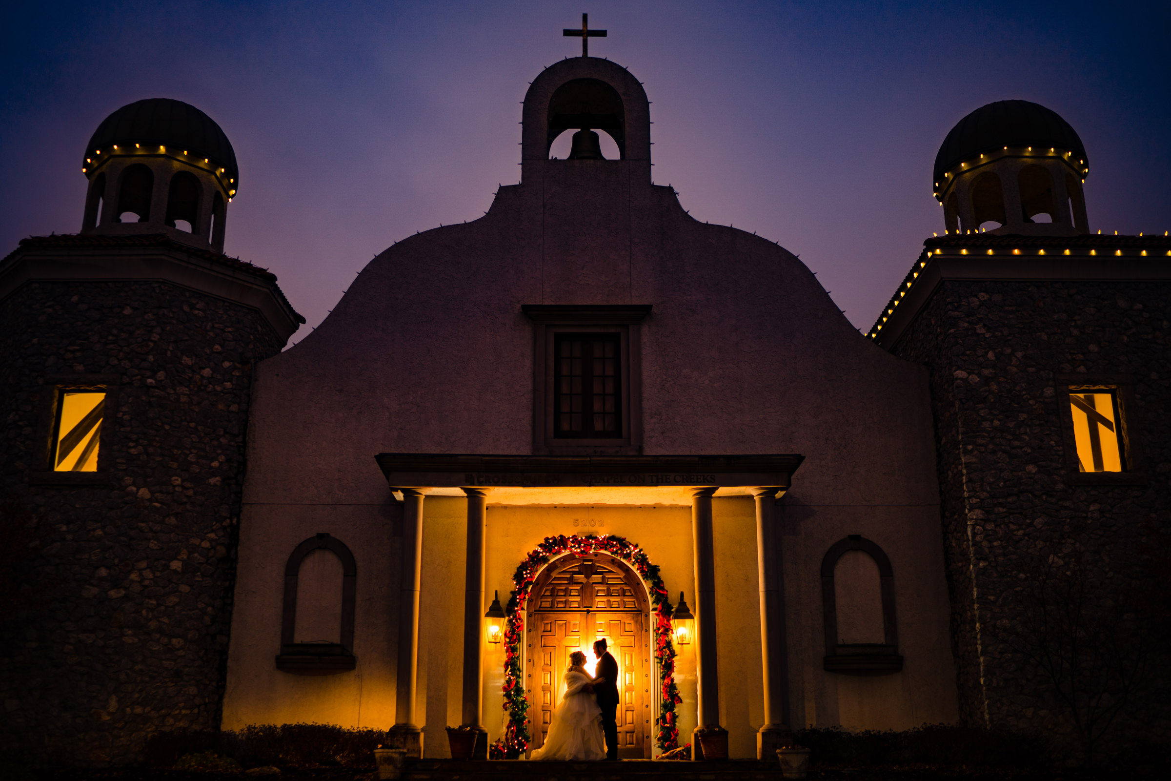 bride-and-groom-back-lit-portrait-in-front-of-their-church-arkansas-photographer-photo-by-vinson-images