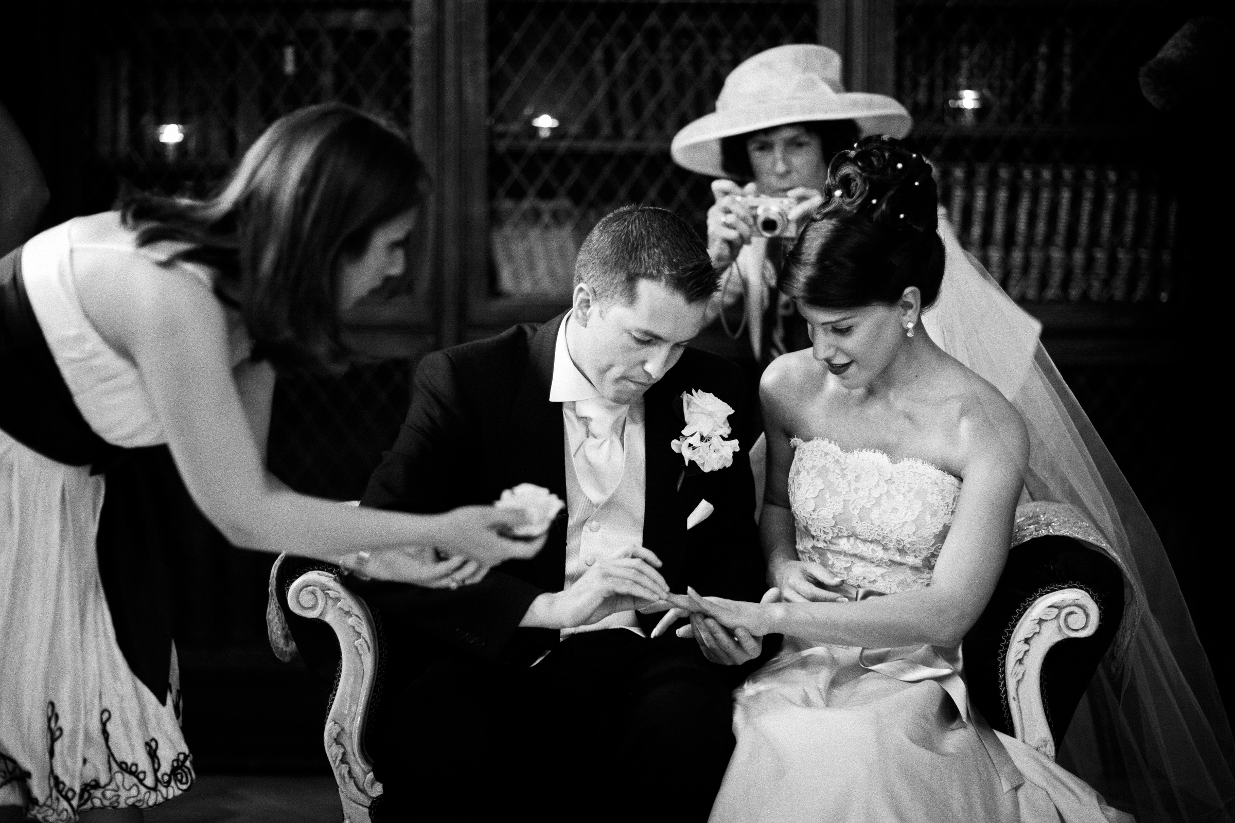 Couple signs their wedding license while mom snaps picture - photo by Jeff Ascough