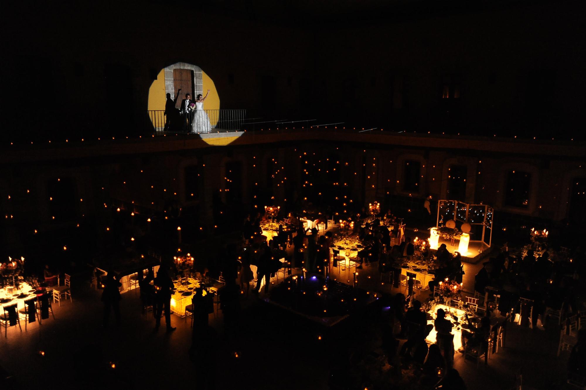 bride-and-groom-in-spotlight-reception-entrance-worlds-best-wedding-photos-daniel-aguilar-houston-wedding-photographers