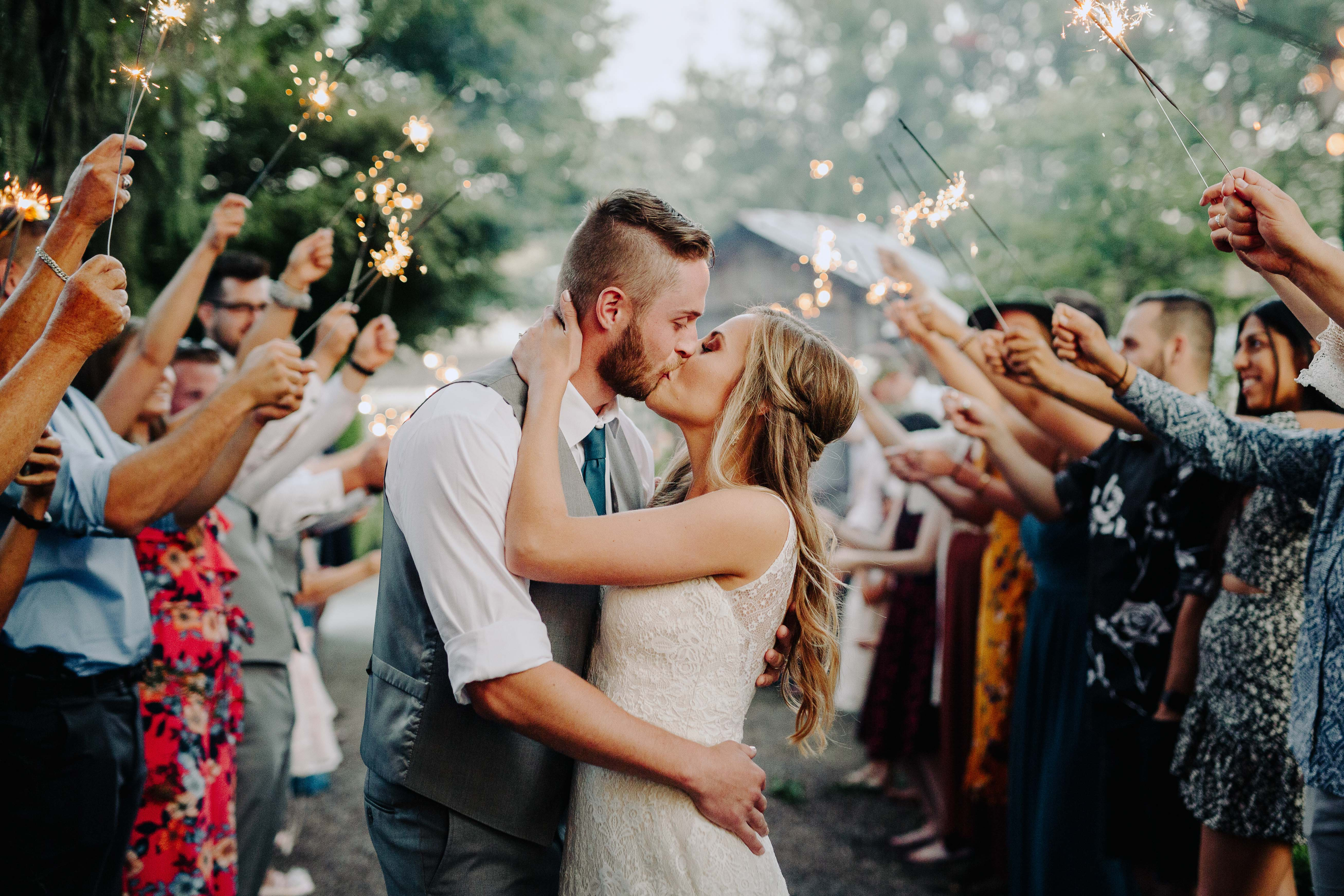 bride-and-groom-kiss-at-sparkler-exit-photo-by-cameron-zegers-photography