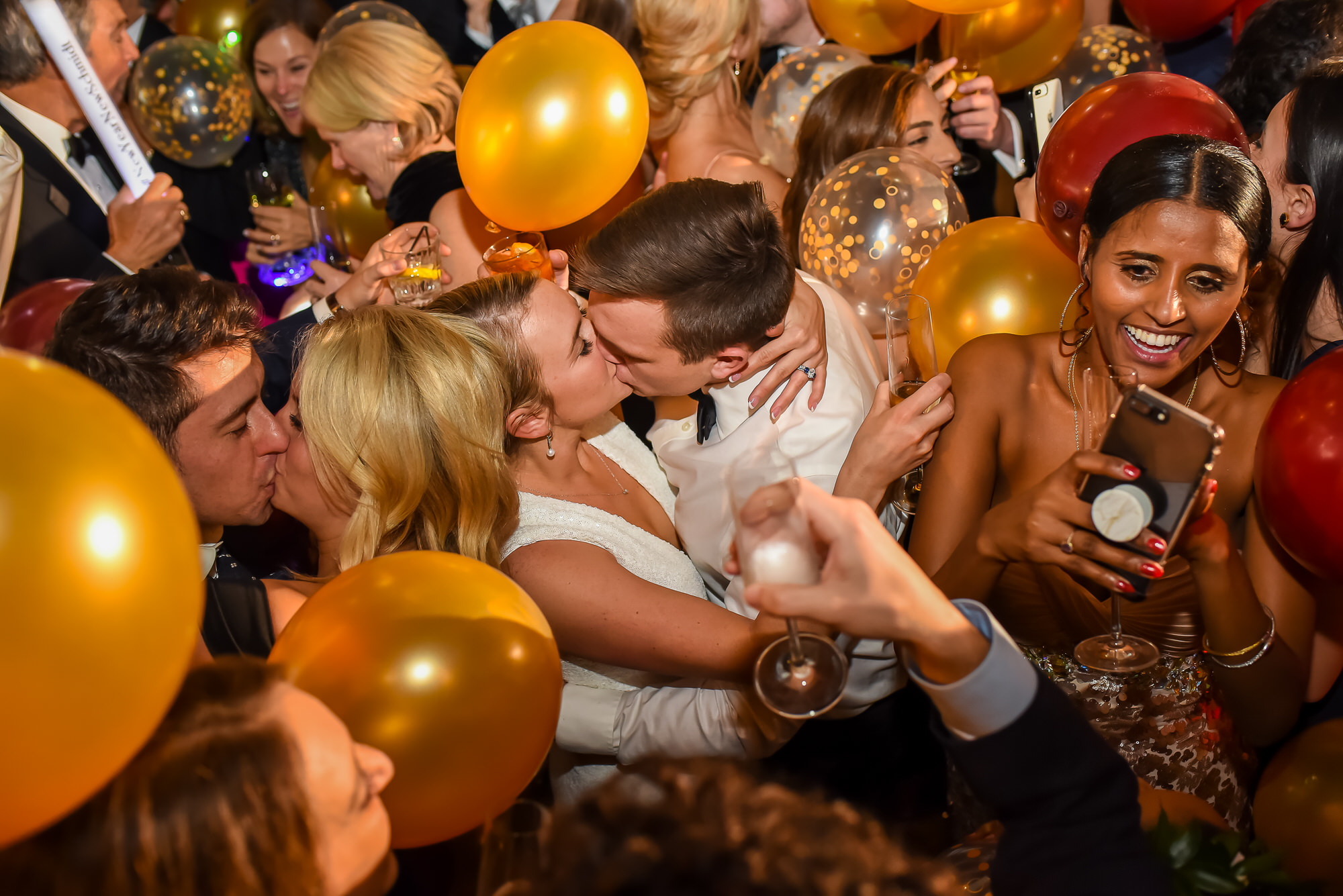 Documentary photo of bride and groom kissing on New Year's Eve by Kansas City photographer, Tyler Wirken