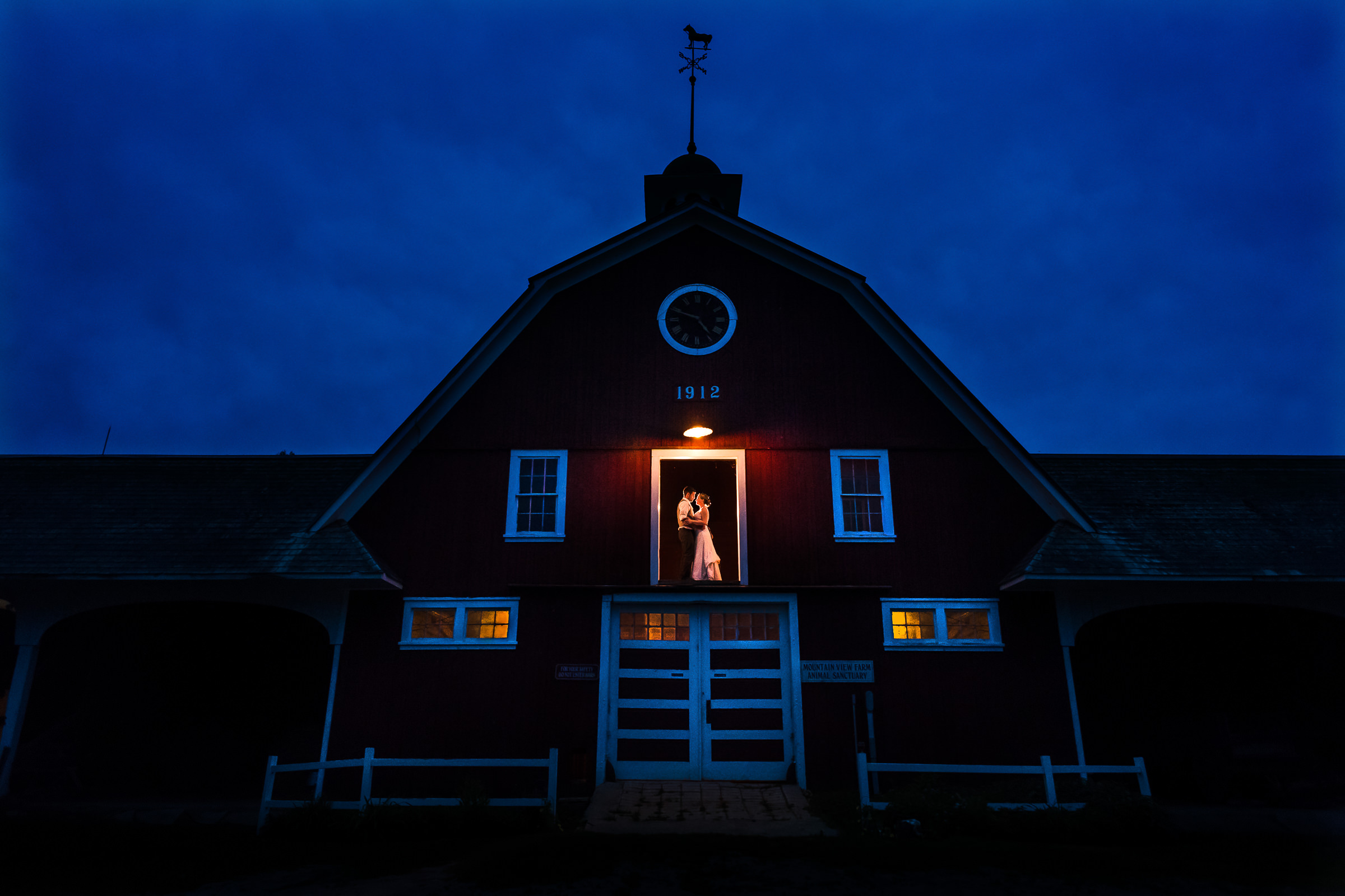 ride-and-groom-portrait-in-the-barn-at-twilight-photo-by-hannah-photography.jpg