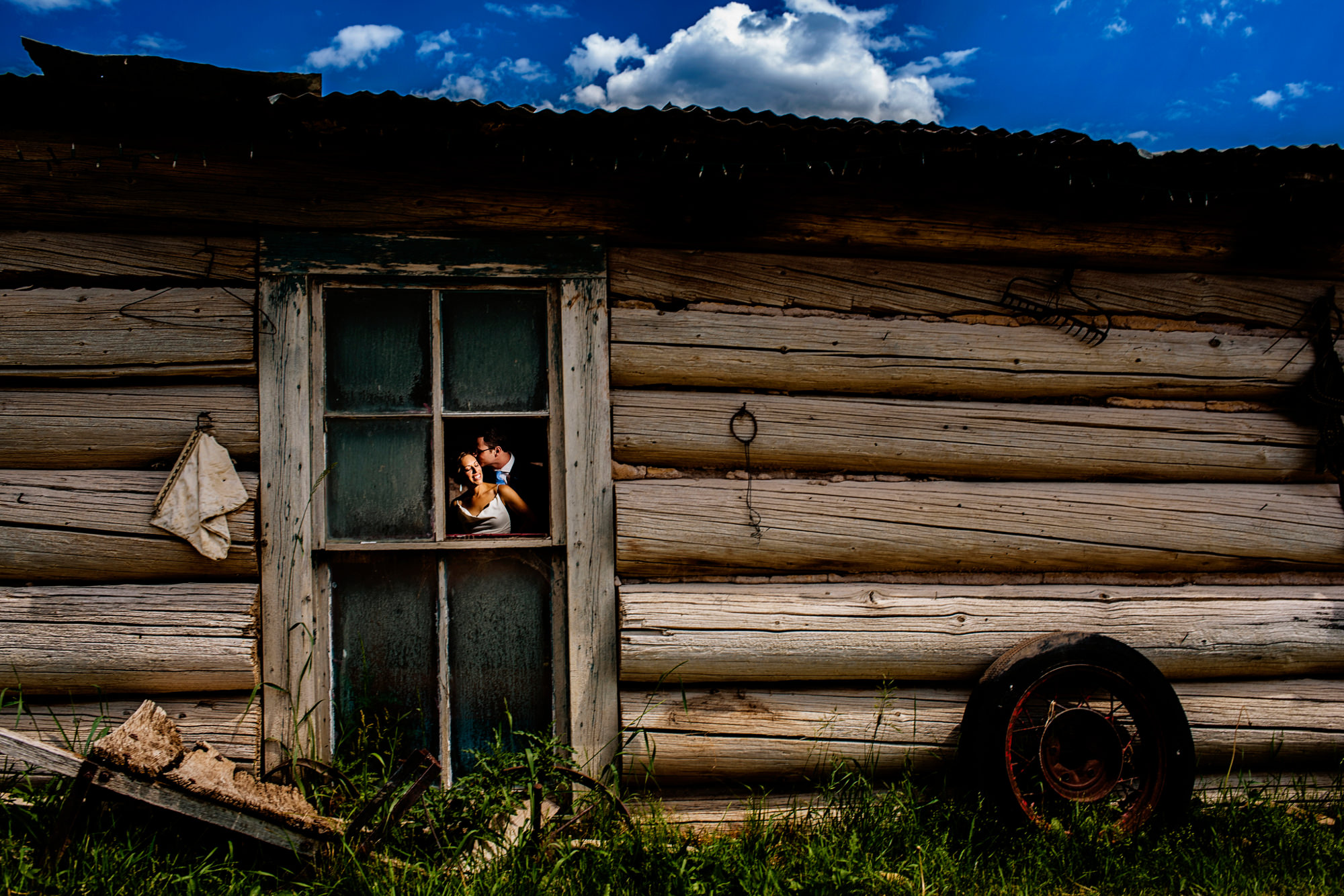 bride-and-groom-portrait-in-window-from-outside-worlds-best-wedding-photos-chrismans-south-carolina-wedding-photographers