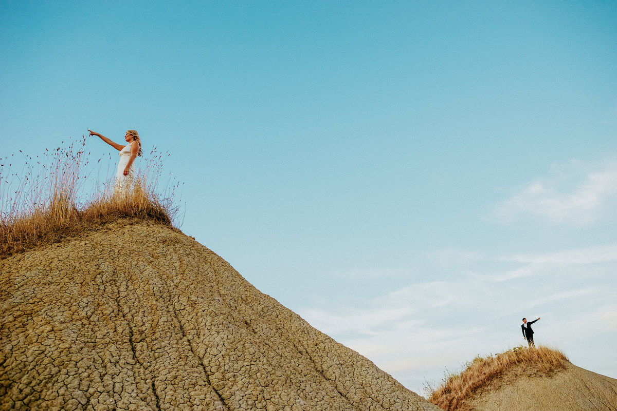 Bride and groom on sand dunes in Pienza Italy, photographed by Samo Rovan