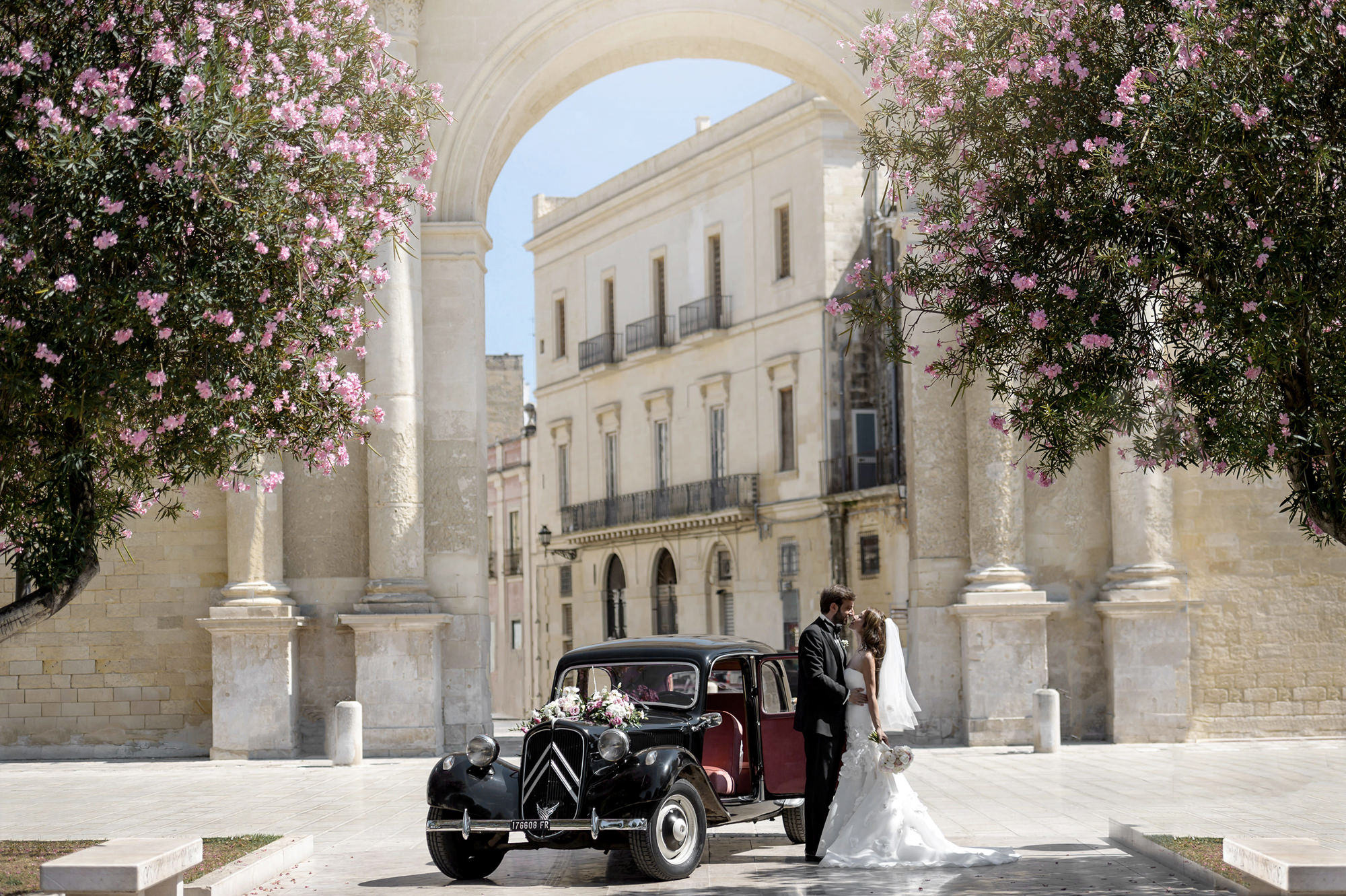 Classic portrait of bride and groom in front of vintage Rolls Royce by 37 Frames photography