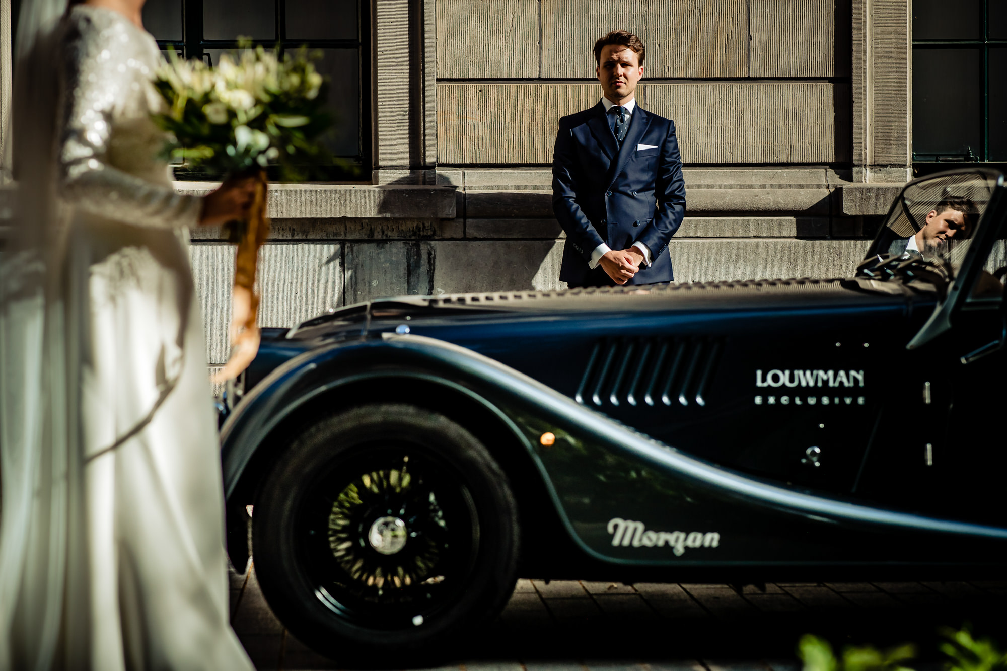 Bride steps toward vintage Morgan, Louman Exclusive, limousine - photo by Eppel Photography