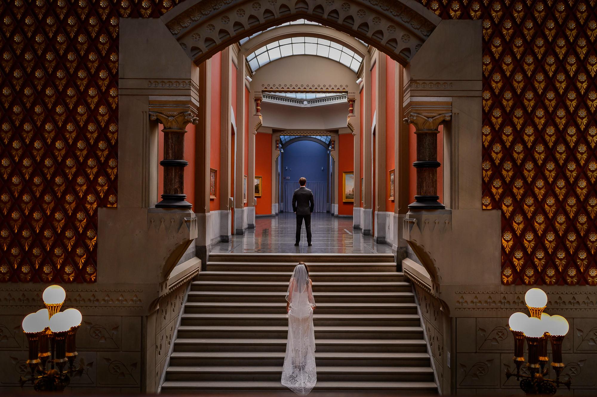 bride-ascends-stairs-at-philadelphia-art-museum-to-meet-groom-christopher-jason-studios