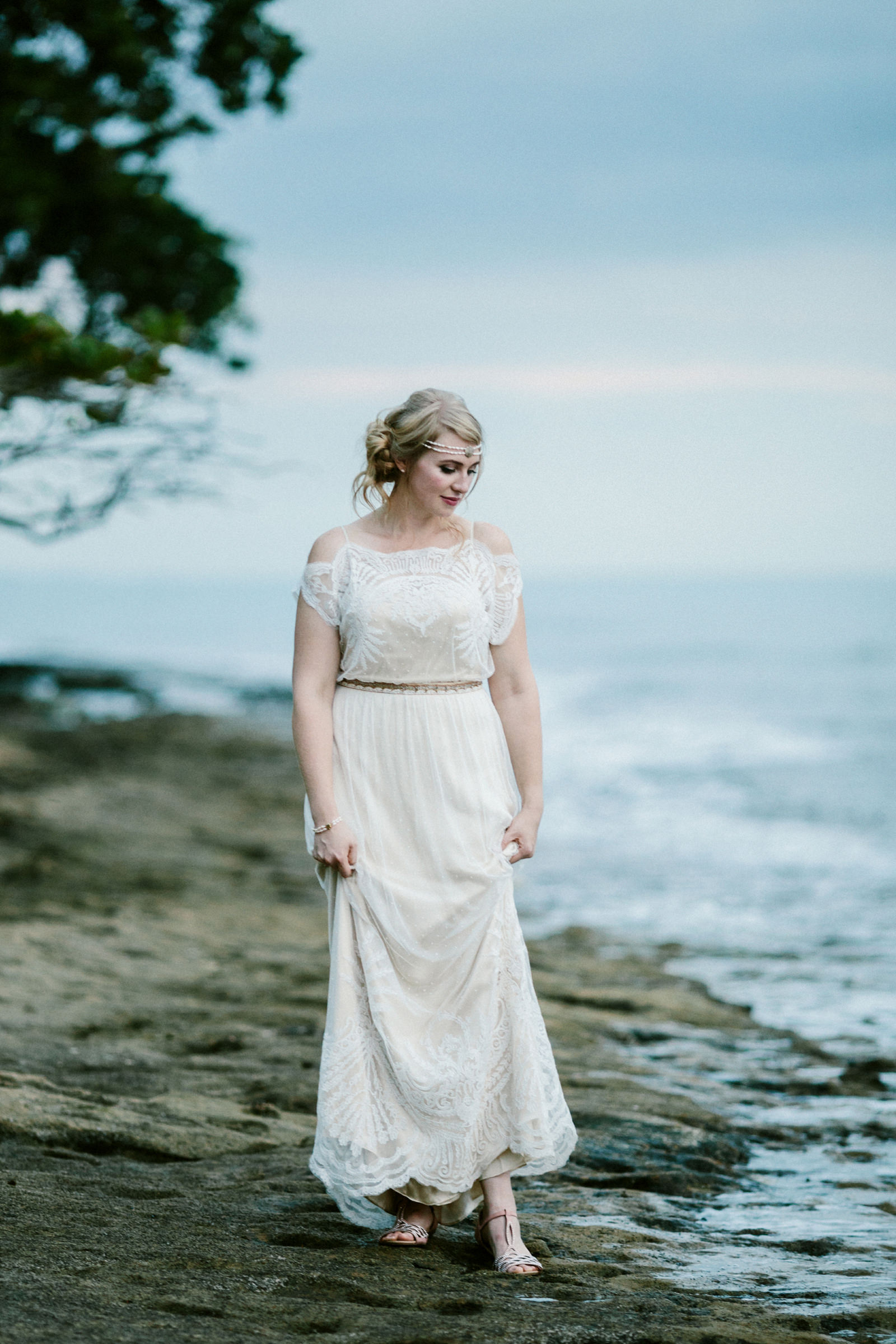 Bride at wateredge in gossamer lace gown - photo by Jonas Seaman - Seattle