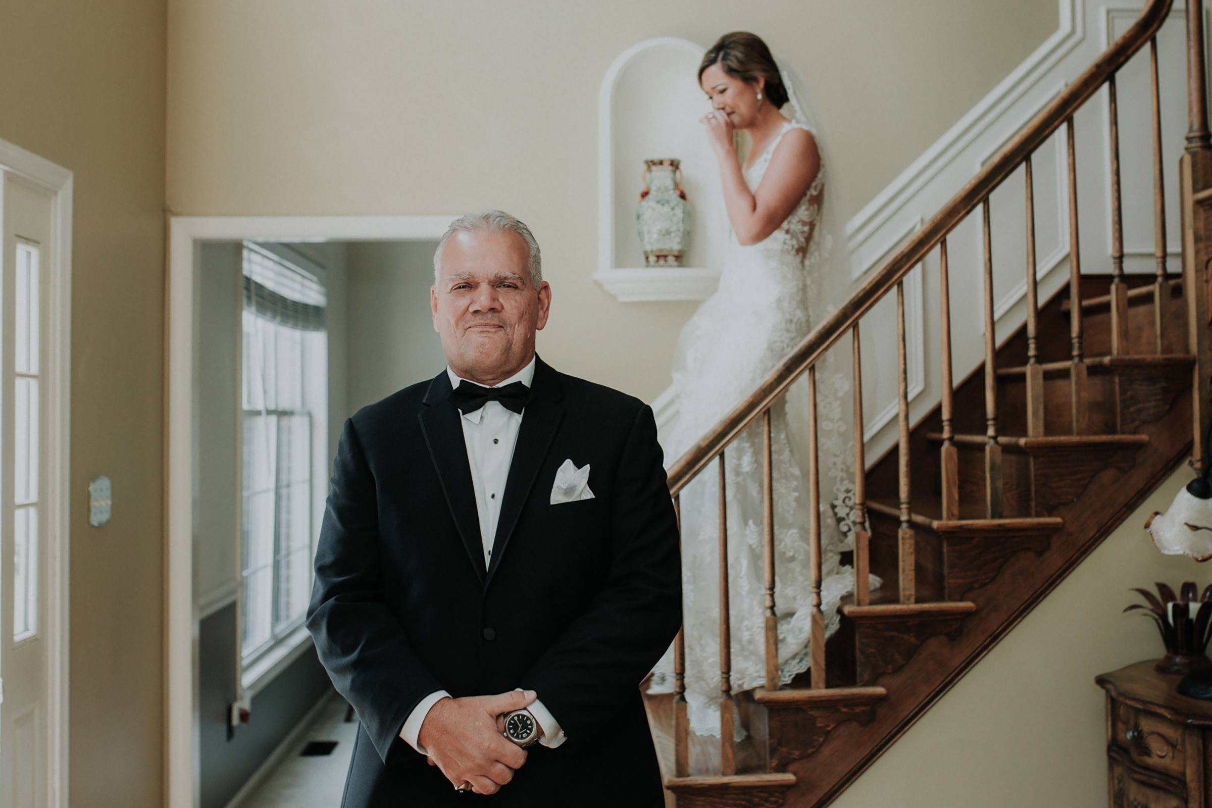 bride-descends-staircase-to-waiting-father-kelli-wilke-photography