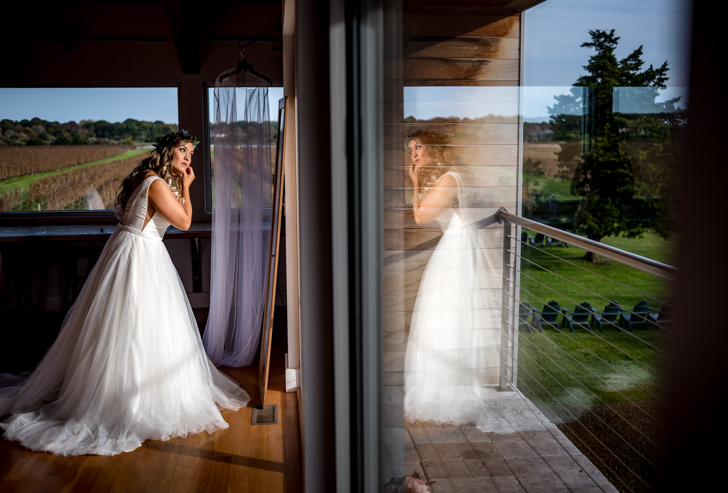 bride-getting-ready-reflected-in-window-randall-garnick-photography