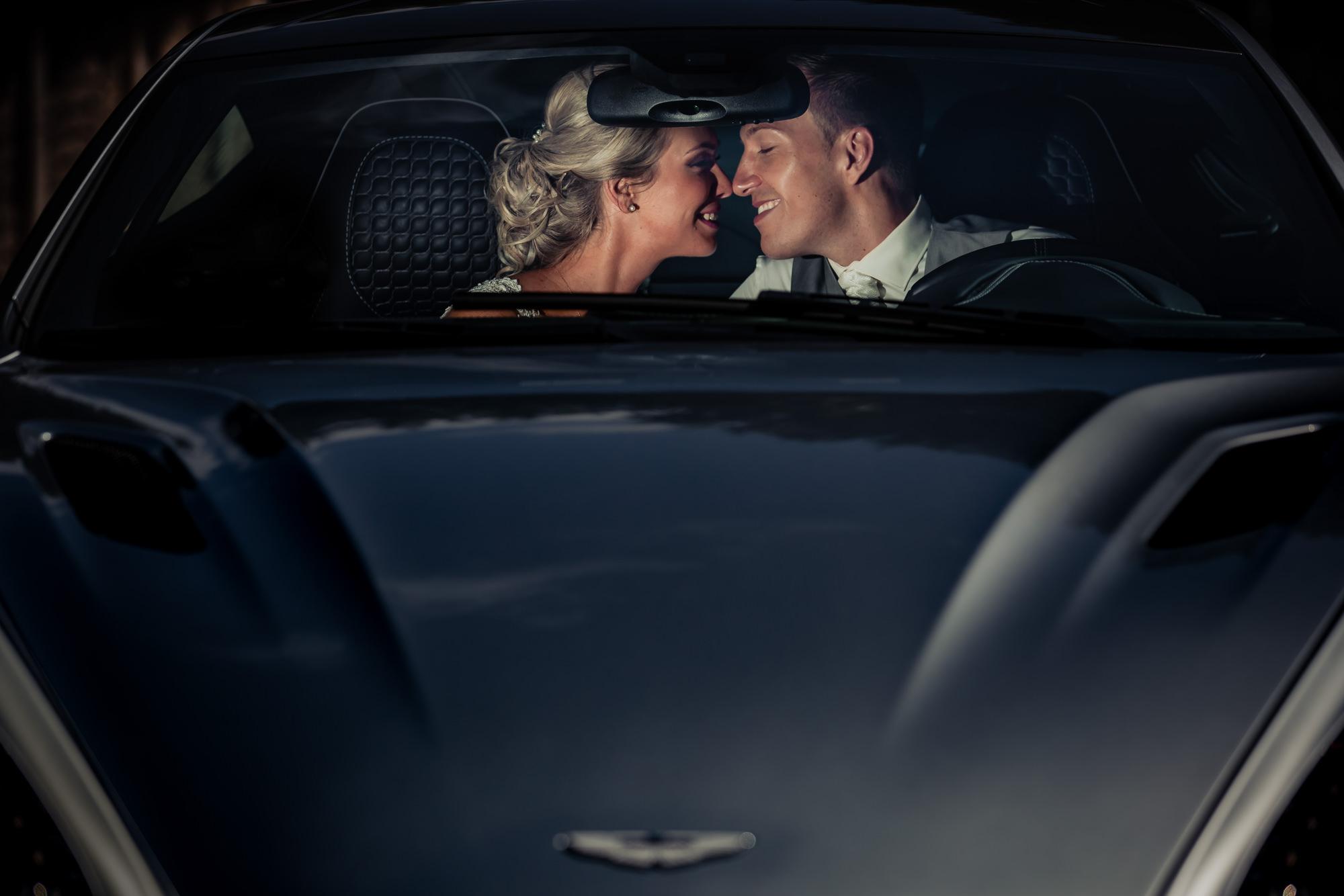 bride-groom-kissing-taken-through-windshield-worlds-best-wedding-photos-eppel-photography-weert-netherlands-wedding-photographers