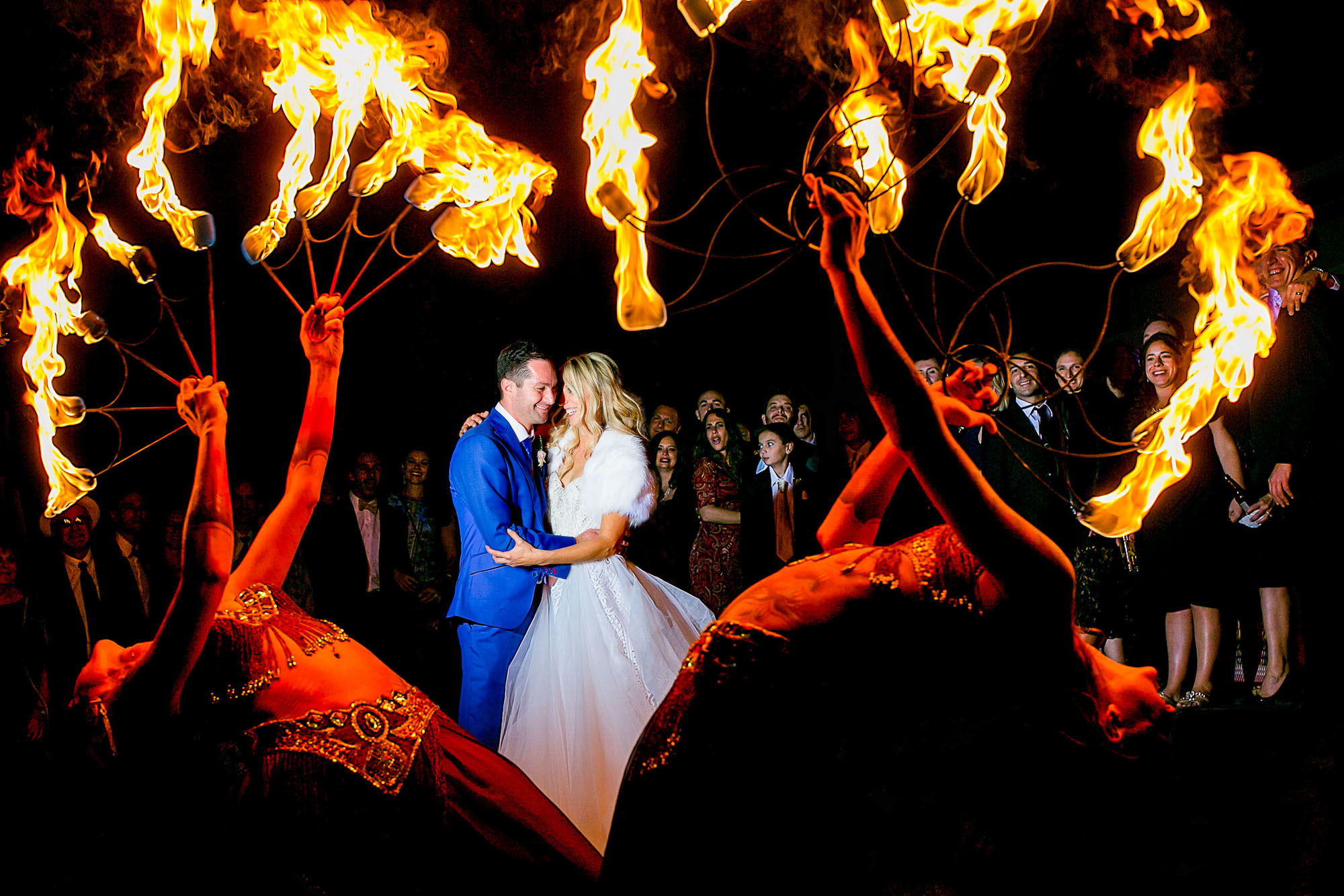 Bride and groom with fire dancers - photo by Jos & Tree - Portland, Oregon