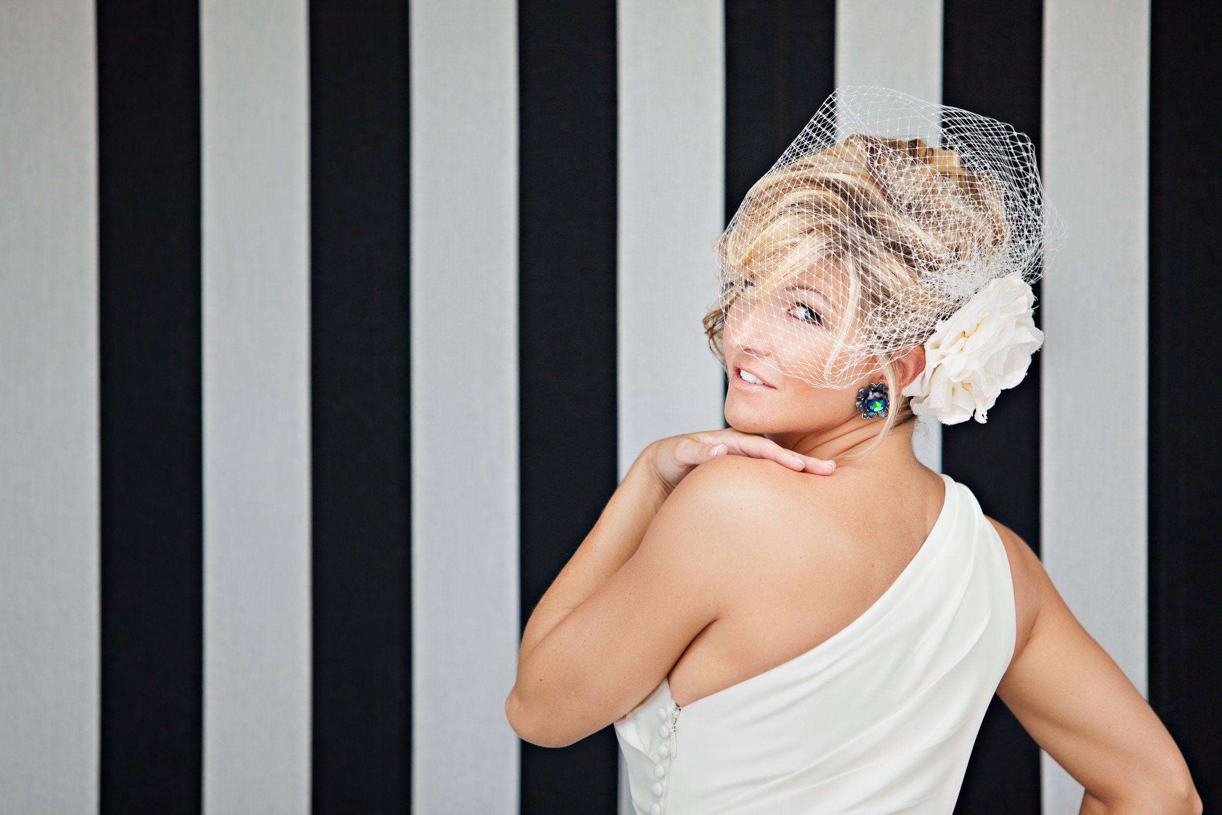 Bride with short blonde hair and birdcage veil - photo by Procopio Photography