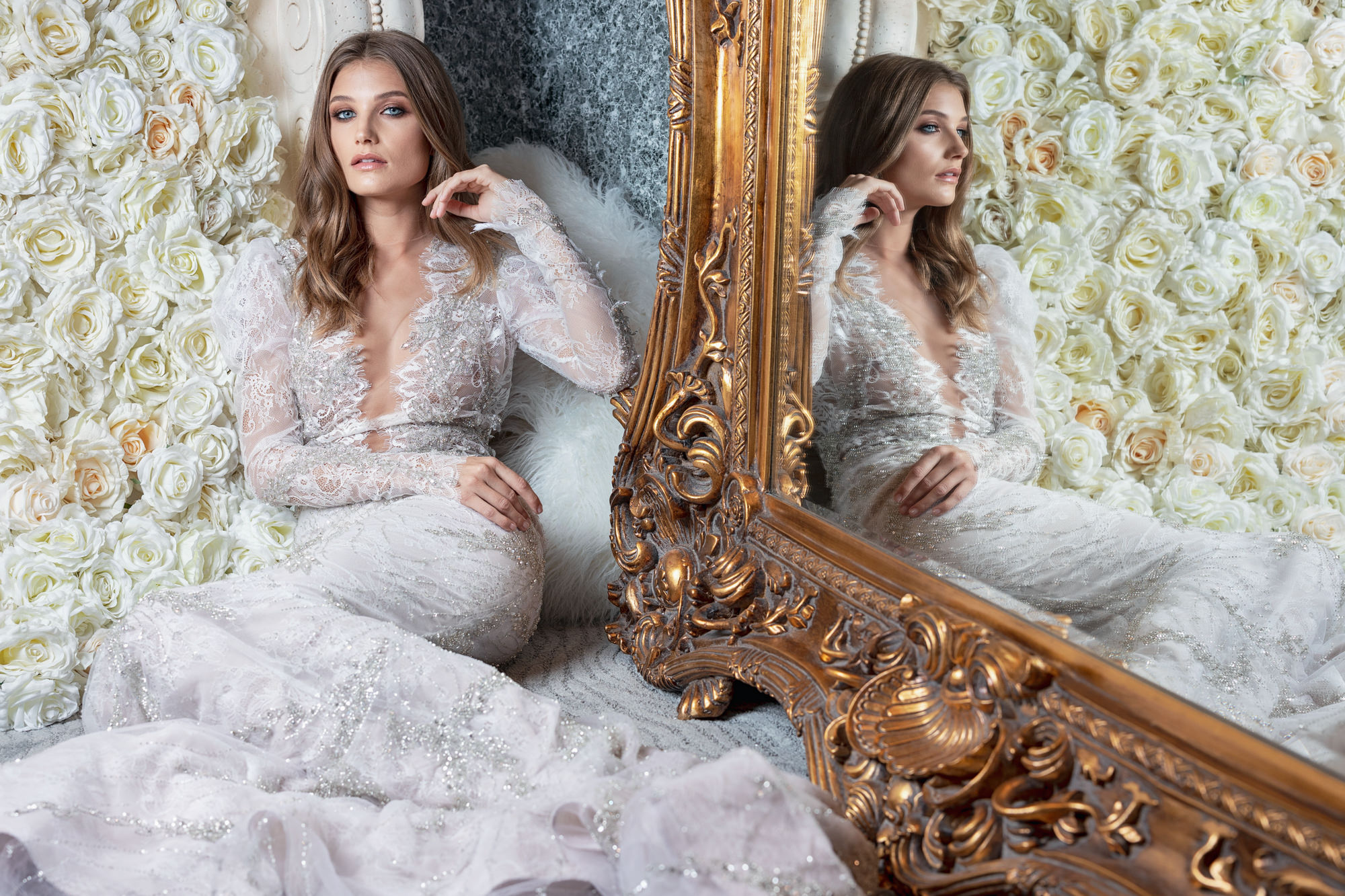 Bride in silver beaded lace couture gown in mirror by Roberto Valenzuela, Los Angeles