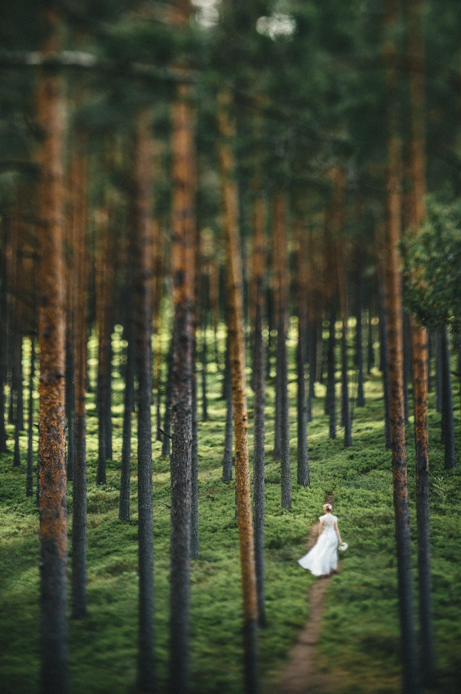 bride-in-forest-in-estonia-m-and-j-studios