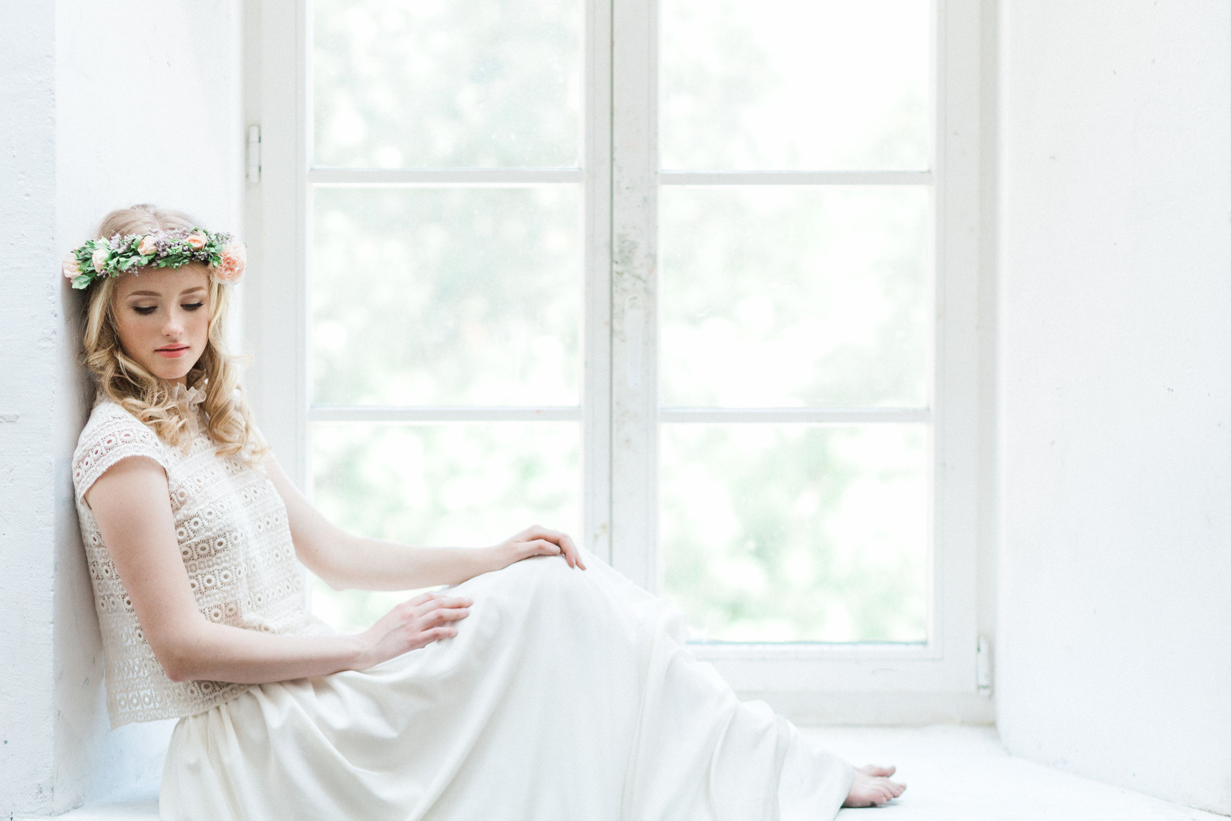 Bride wearing floral crown of pink roses and grape hyacinth - photographed by Jurgita Lukos - Luthuania