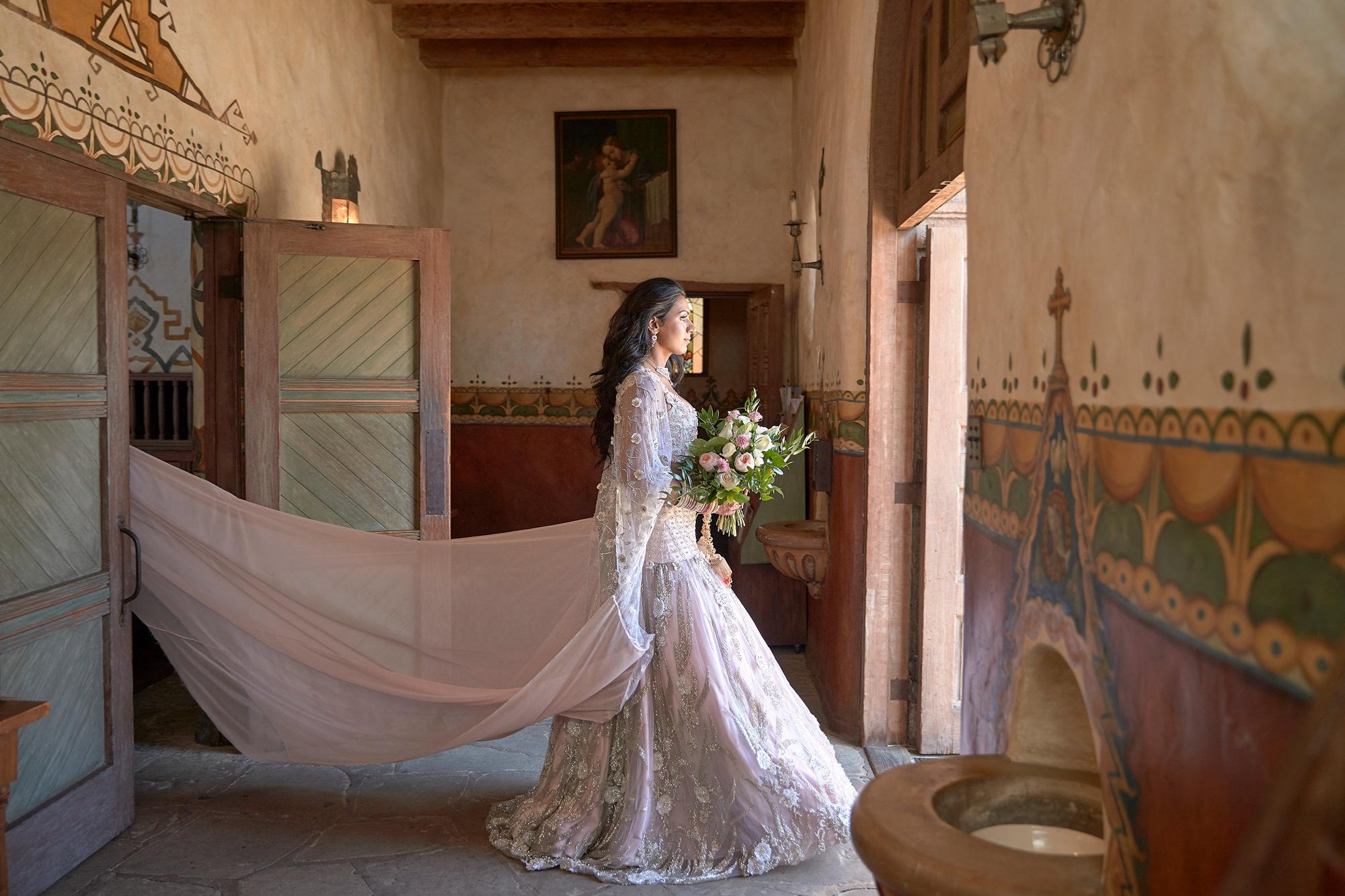 Bride in petal pink beaded wedding gown by Roberto Valenzuela, Los Angeles