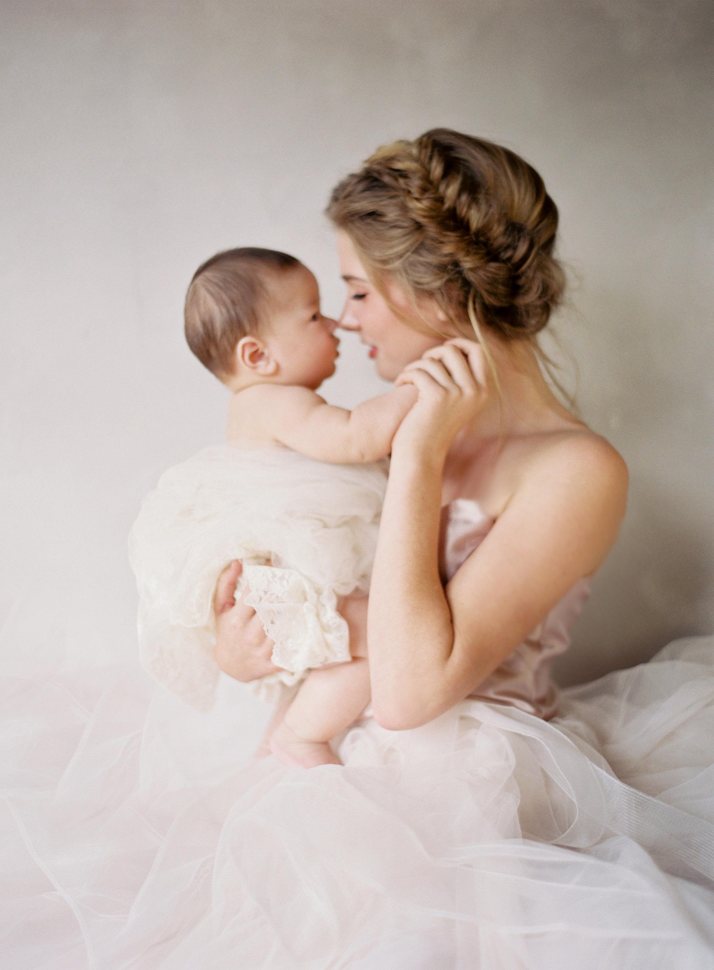 Bride with baby by Jen Huang Bogan of Santa Barbara