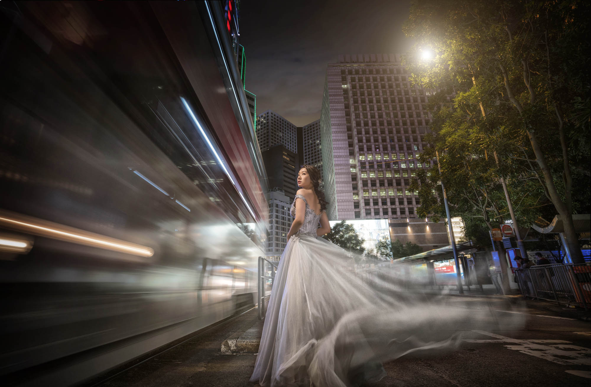 Long exposure portrait of bride on city street in China - photo by CM Leung