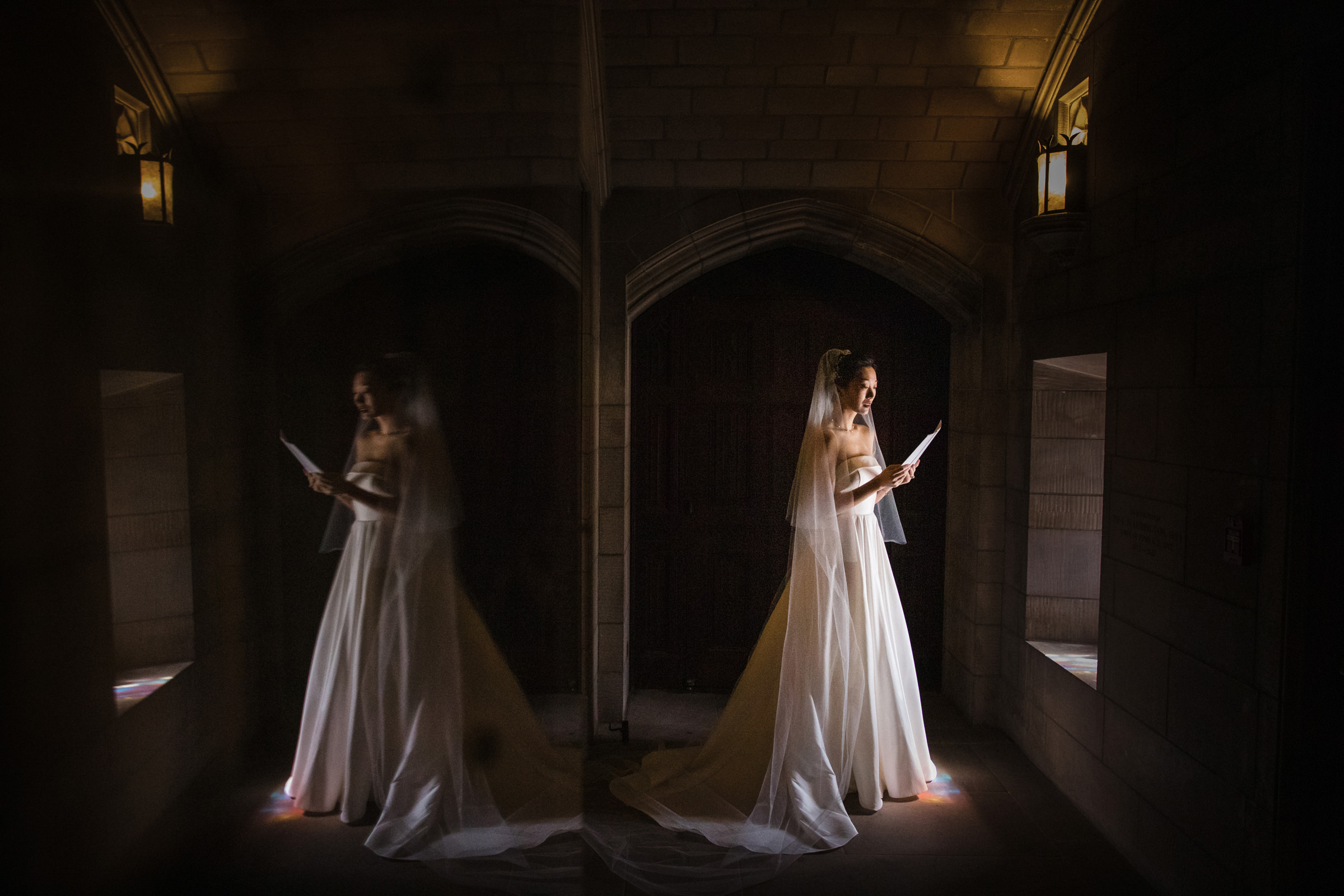 Bride memorizes her vows in soft windowlight - photo by Susan Stripling - New York