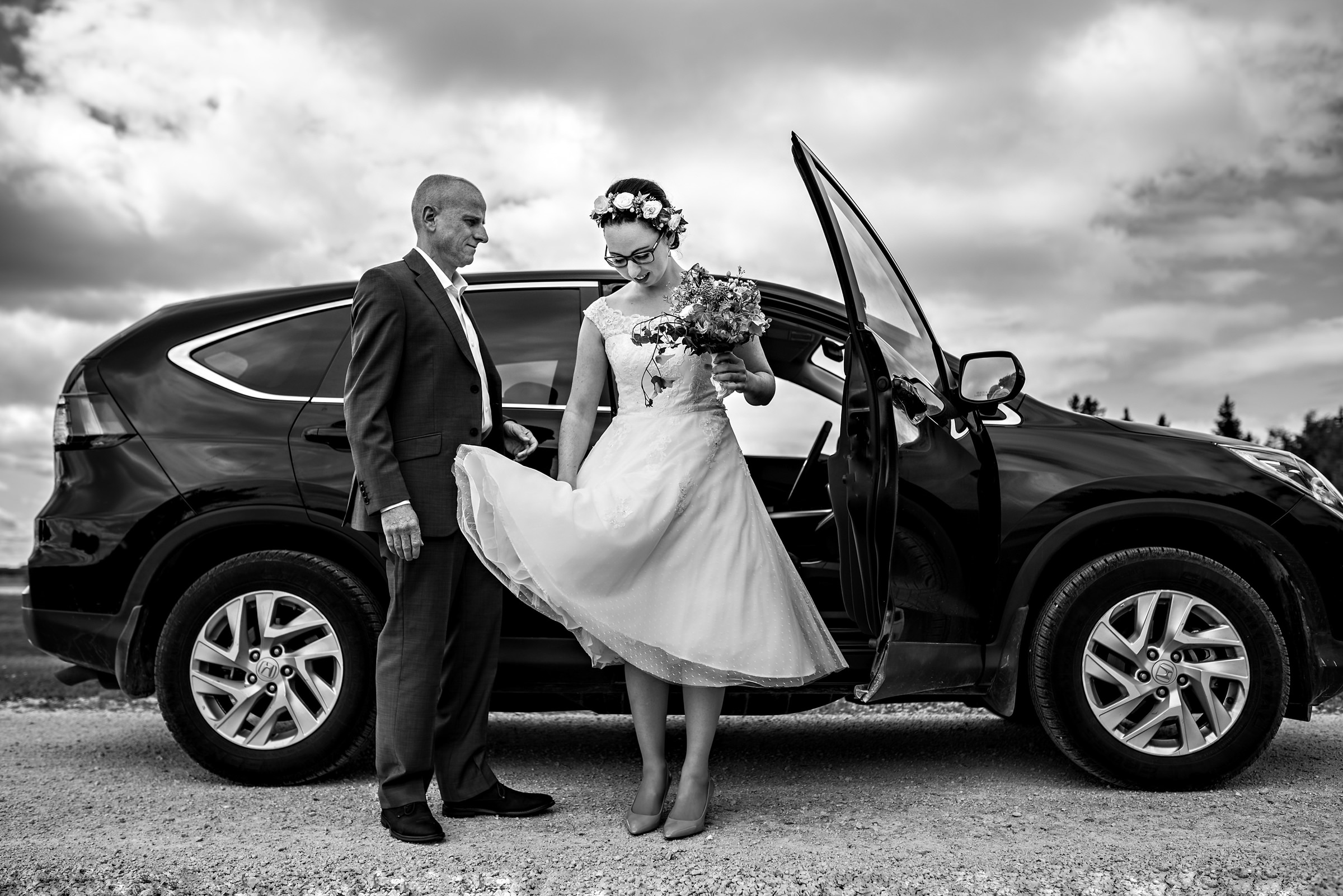 bride-wearing-floral-crown-and-vintage-short-dress-gets-out-of-car-moore-photography