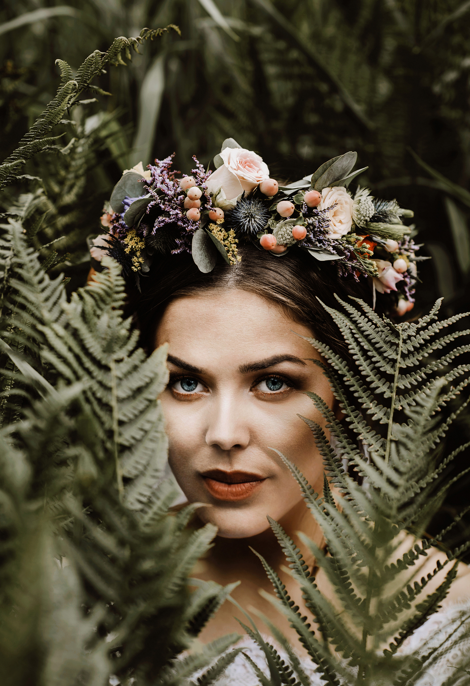 Floral crown of pink roses, sage, berries, and thistle photographed by Froydis Geithus - Sweden