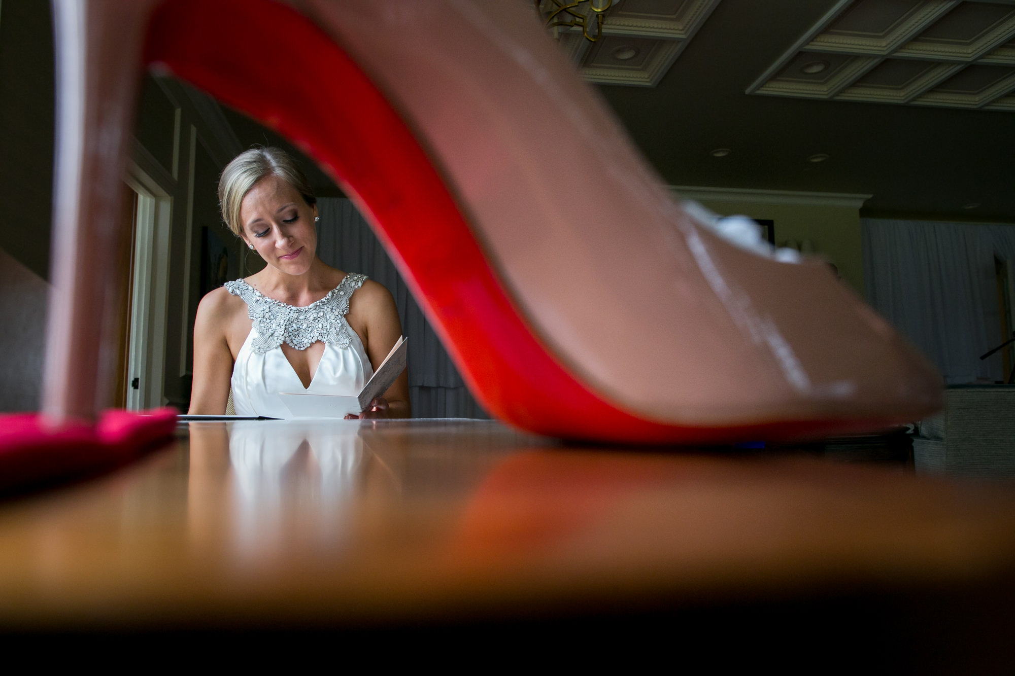 Creative capture of bride reading photographer through her shoe by Jessica Hill Photography Portland