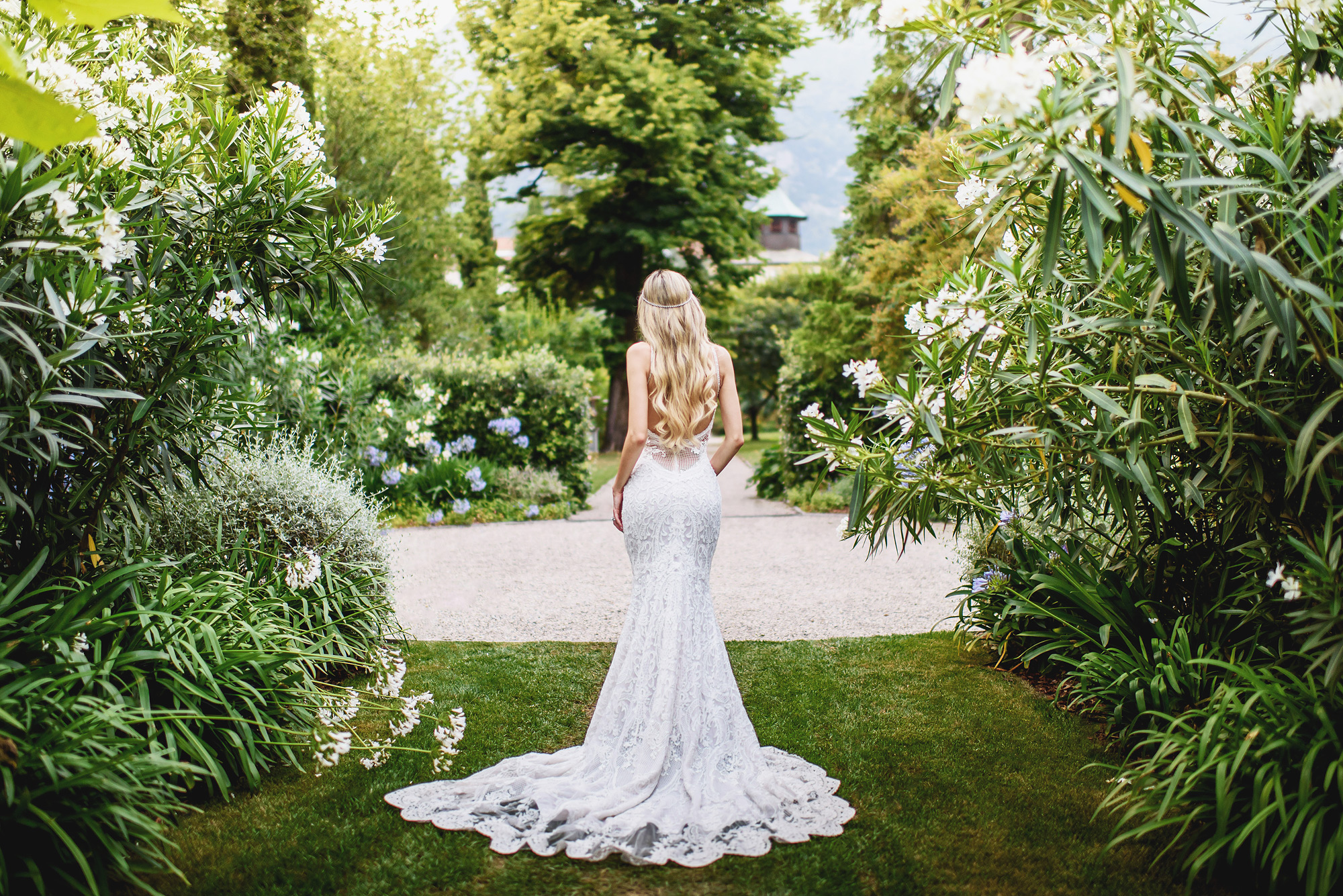 Back of low back lace dress worn by blonde bride - photo by Ross Harvey