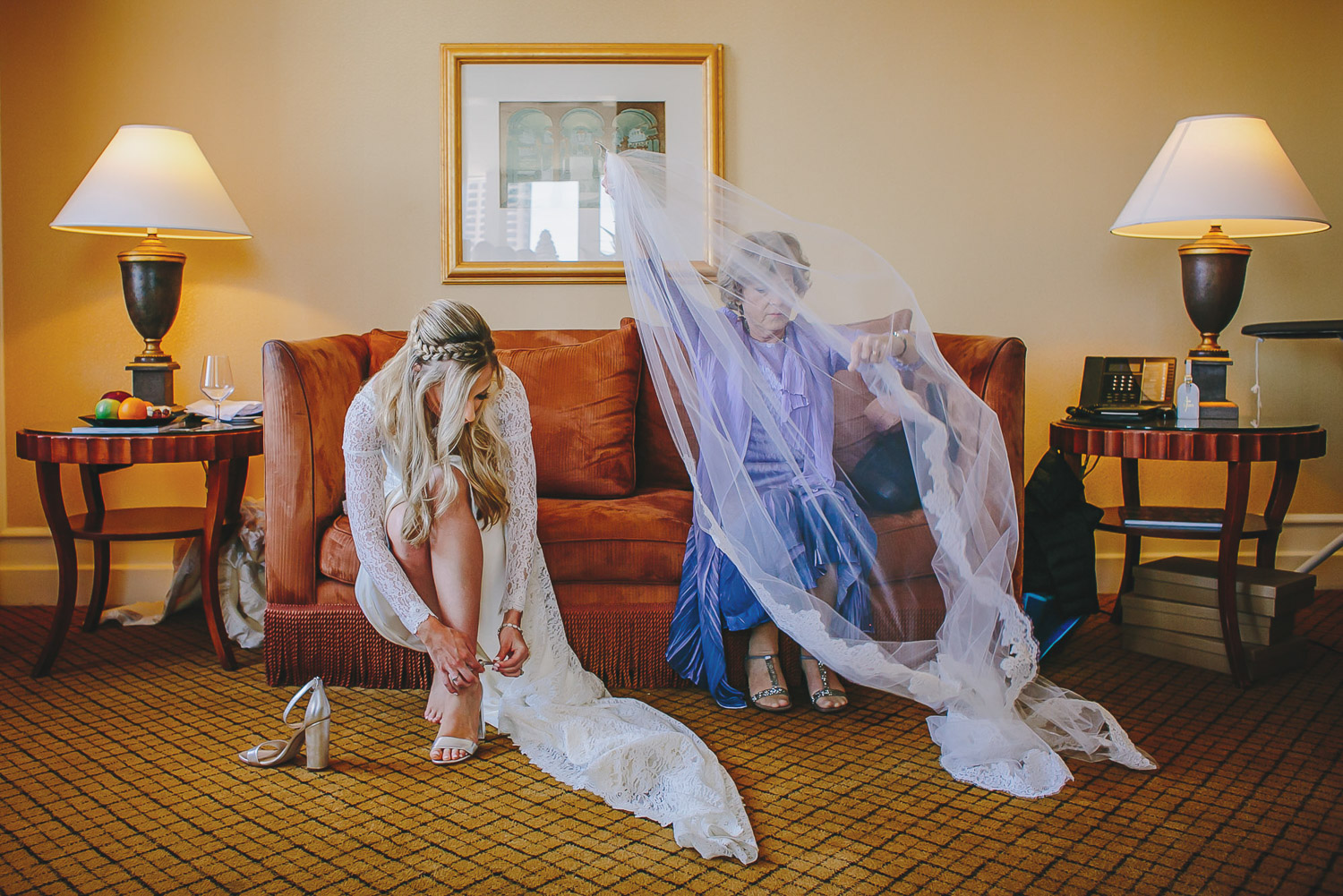 bride-with-mom-getting-veil-ready-carolines-collective