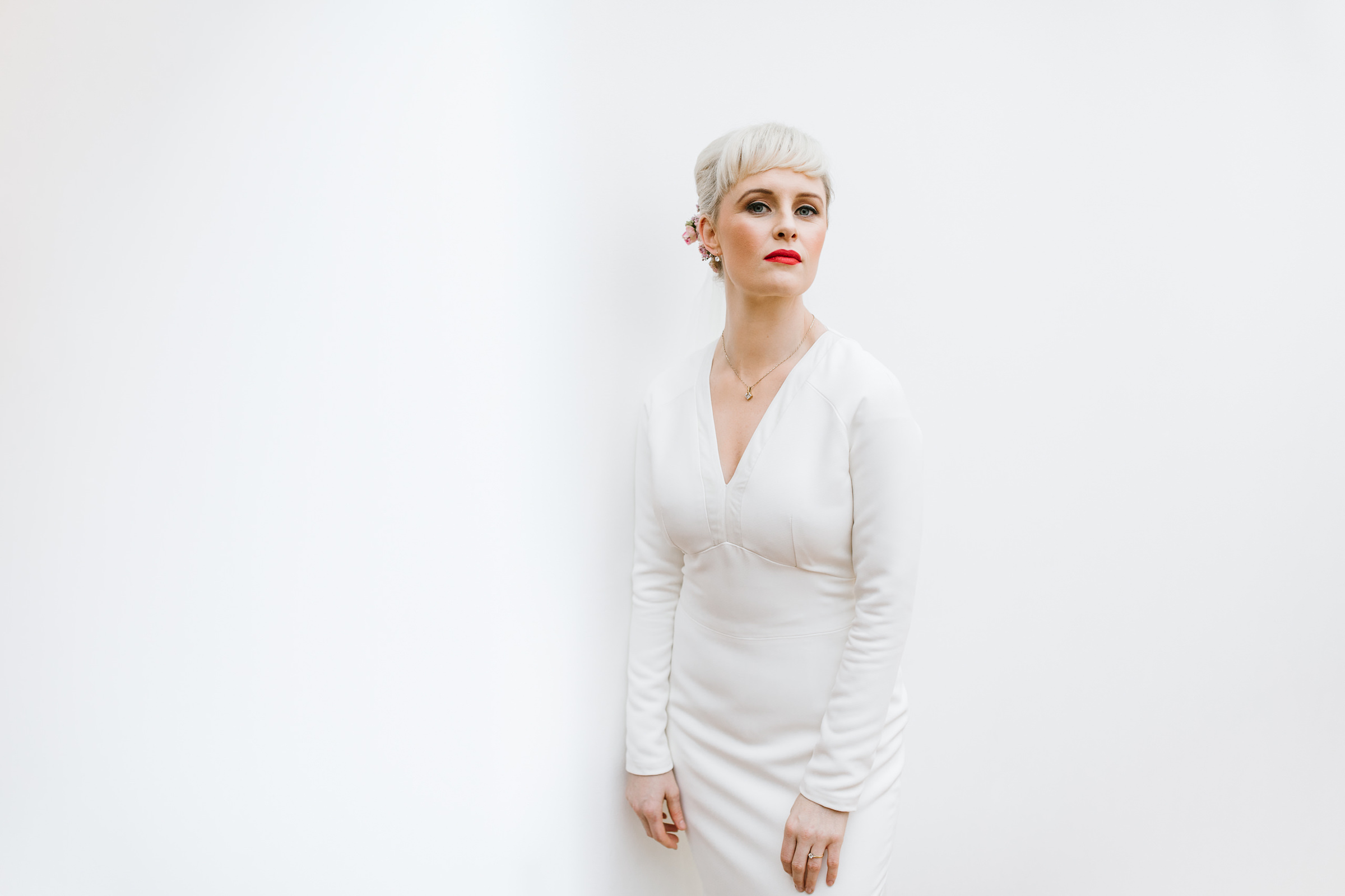 Bride with short white hair, brown eyeshadow, and bright red lips - photo by White Cat Studios - Ireland