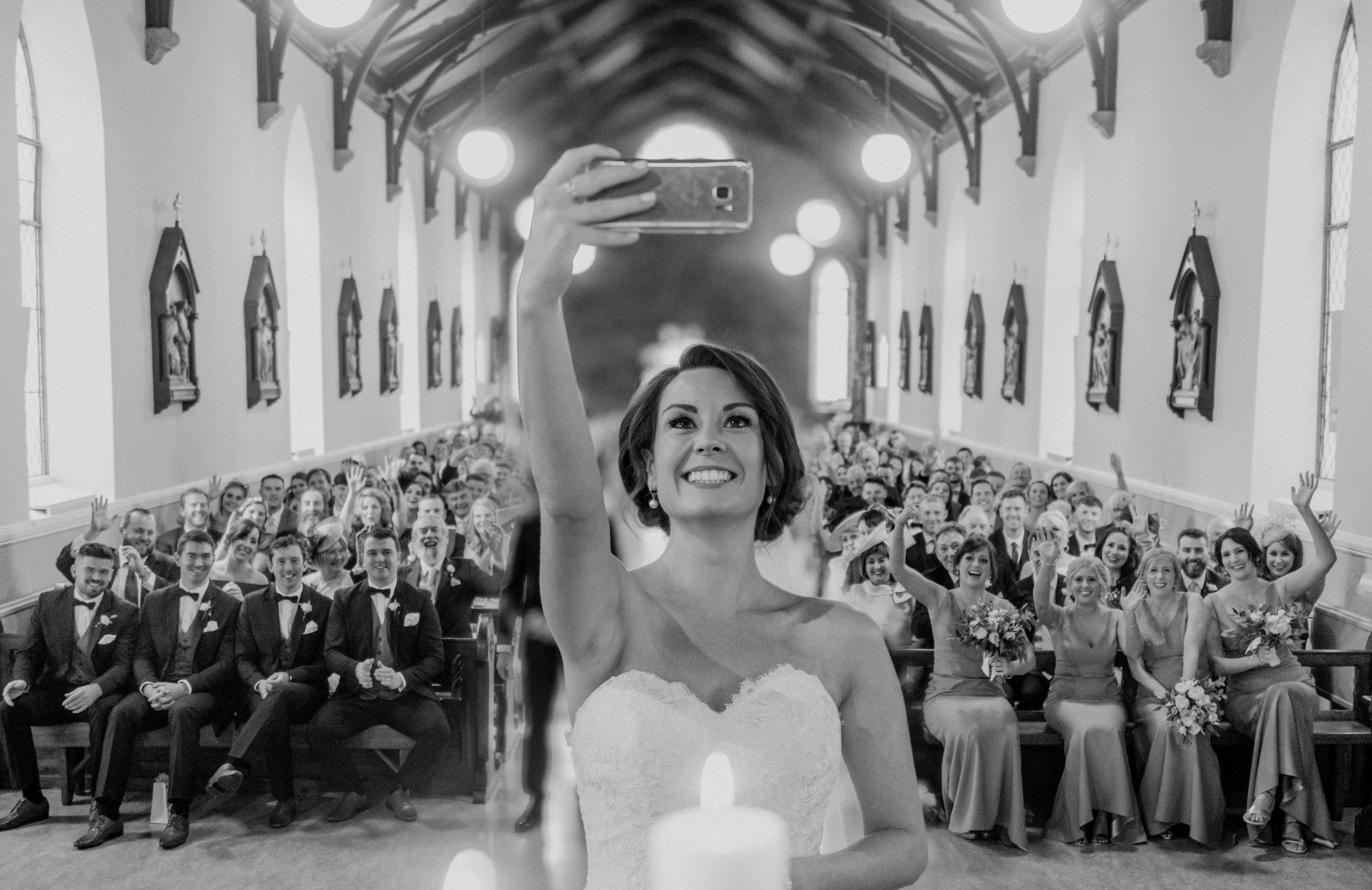brides-takes-group-selfie-in-the-church-john-gillooley