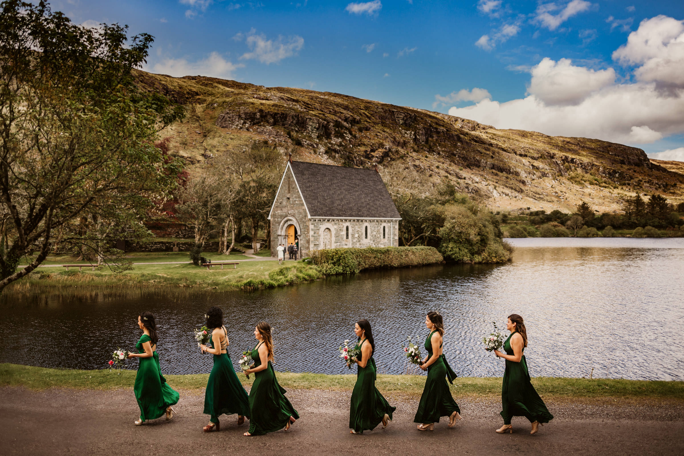 Bridesmaid head to church in flowing emerald green dresses - photographed by Lima Conlon - Ireland