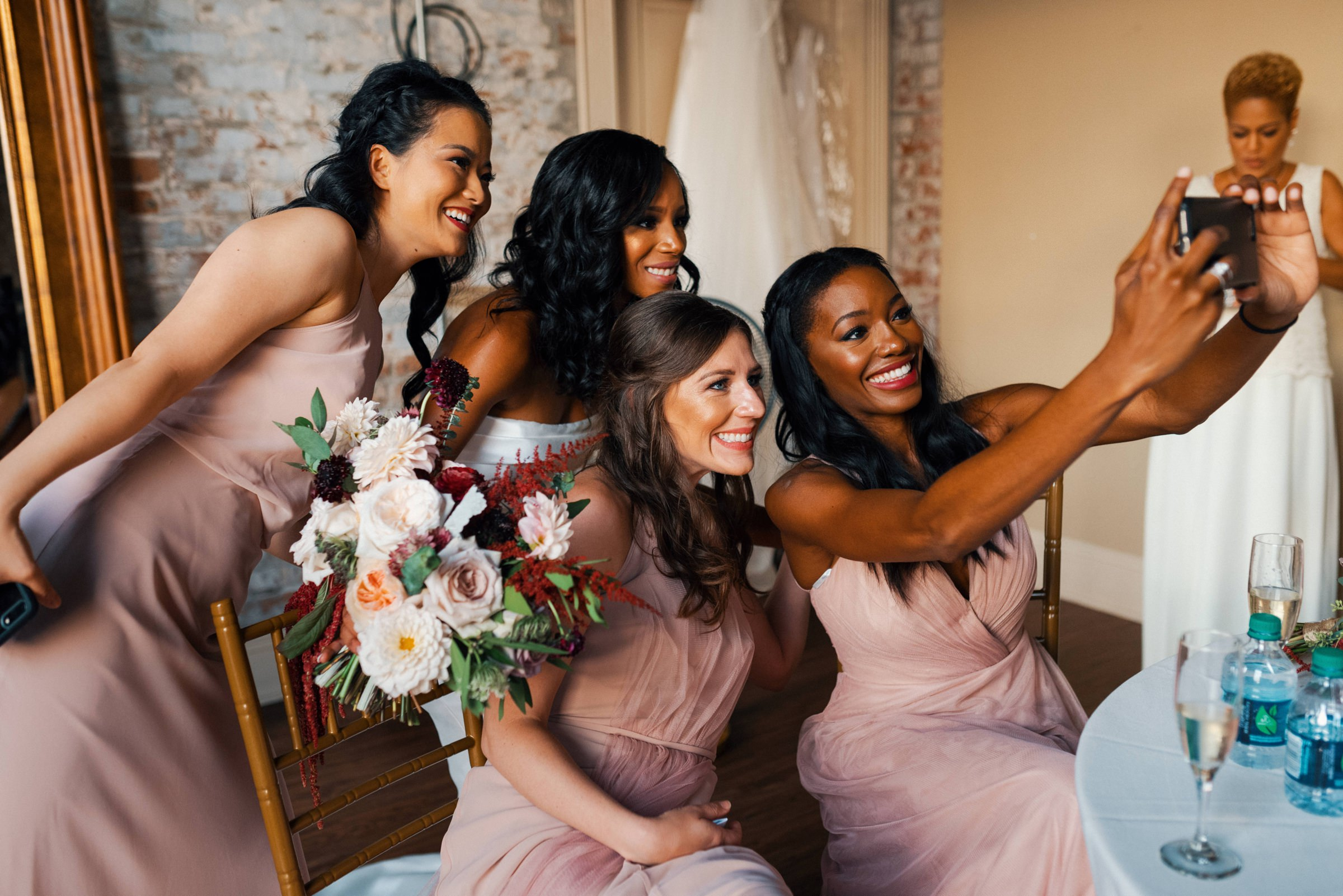 bridesmaids-taking-selfie-new-orleans-austin-houston-wedding-photo-by-dark-roux