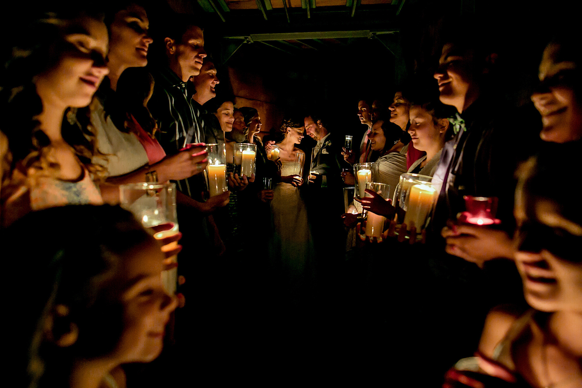 candlelight-prayers-with-guests-worlds-best-wedding-photographers-portland-wedding-photographers