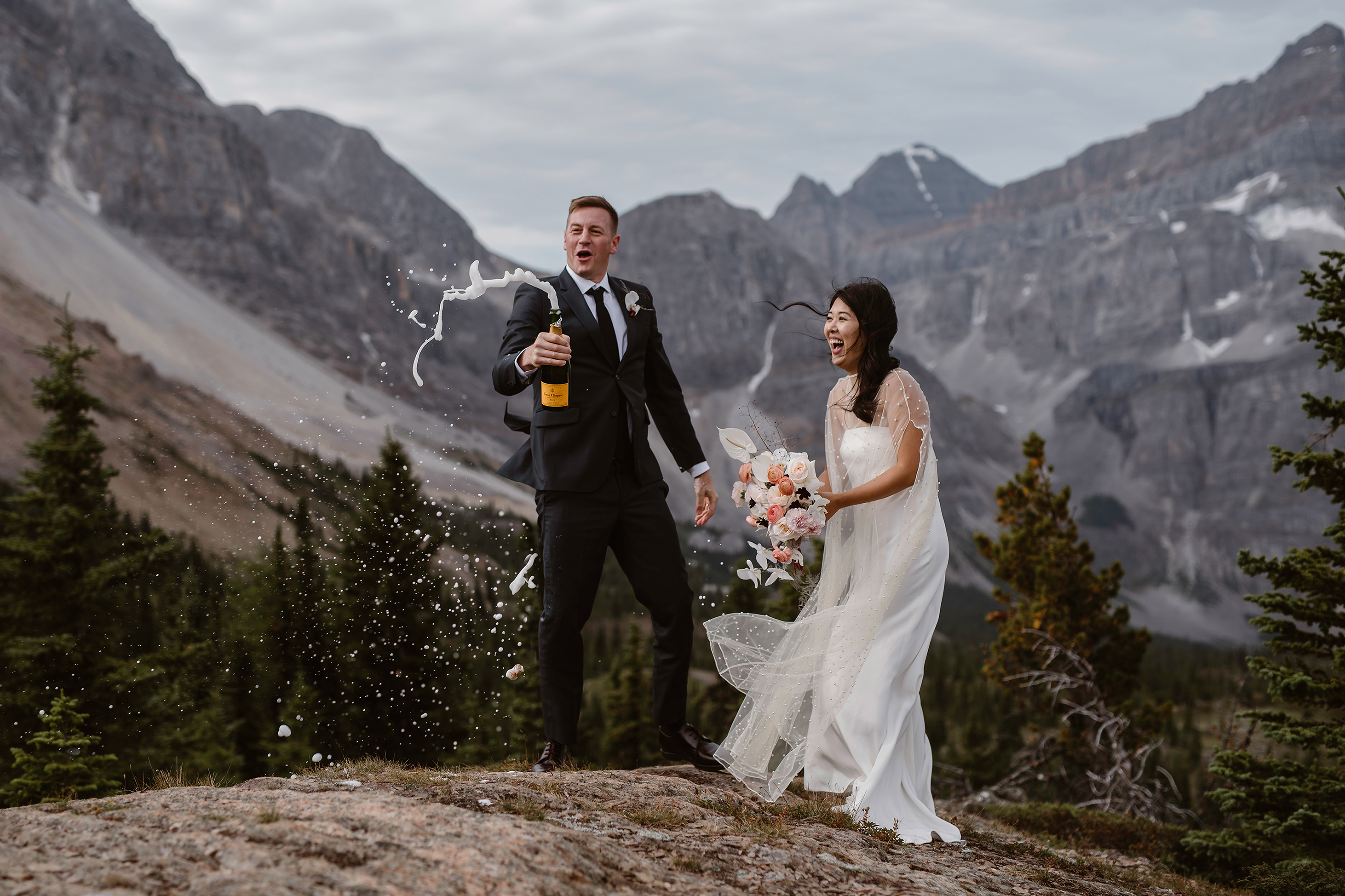 Champagne toast at Lake Moraine on a cloudy day - photo by Virginia and Evan