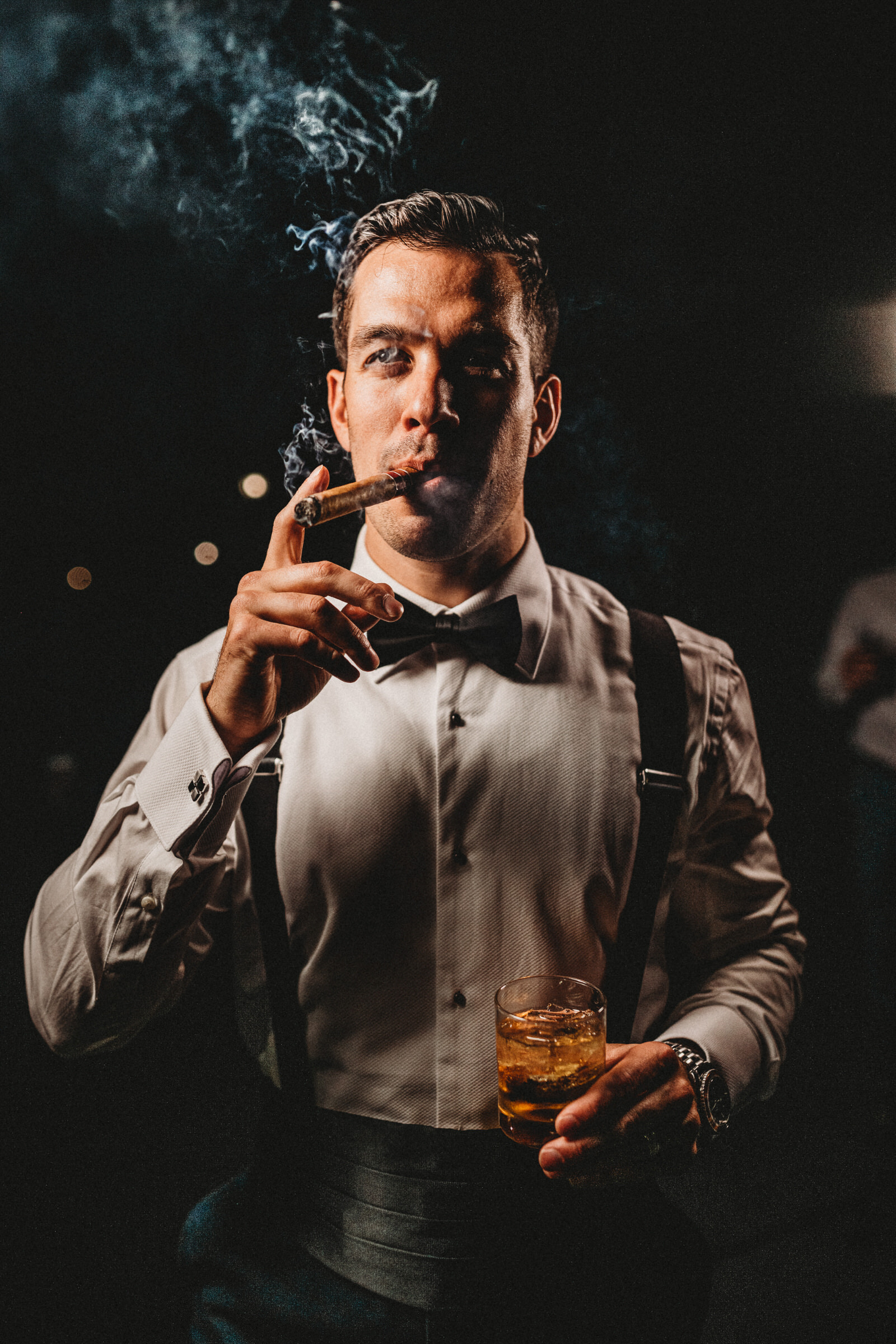 close-up-portrait-of-groom-with-cigar-photo-by-esteban-gil-photography-connecticut