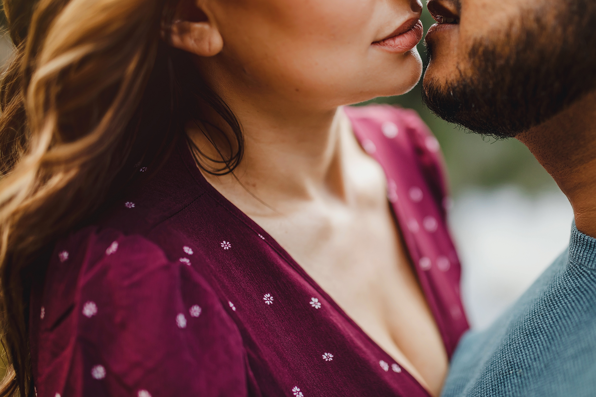 Close-up engagement photo of woman with russet lipstick kissing her finance - photo by Ruan Redelinghuys