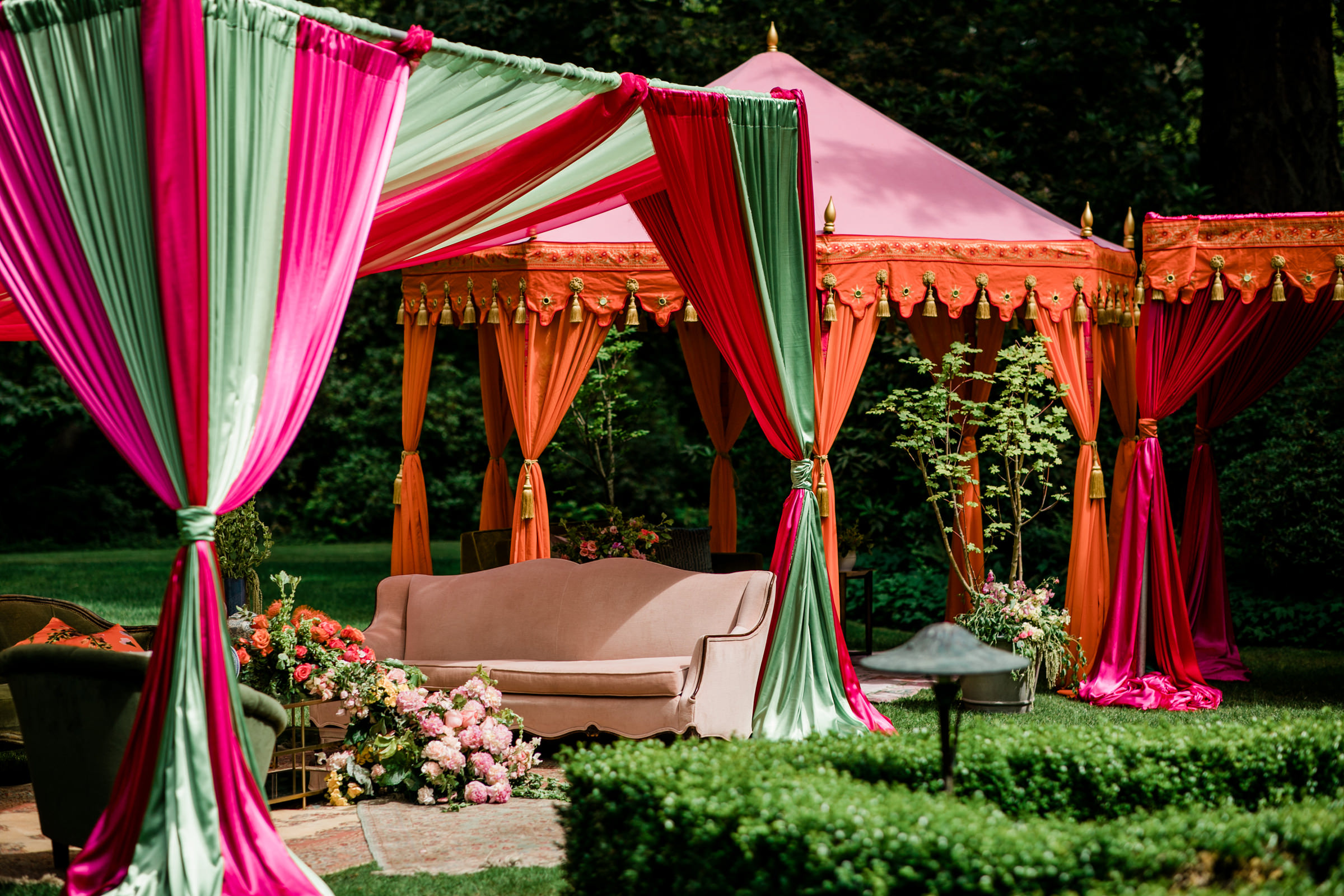 Silk wedding reception tents in red, green and orange photographed by Into Dust Photography - Seattle