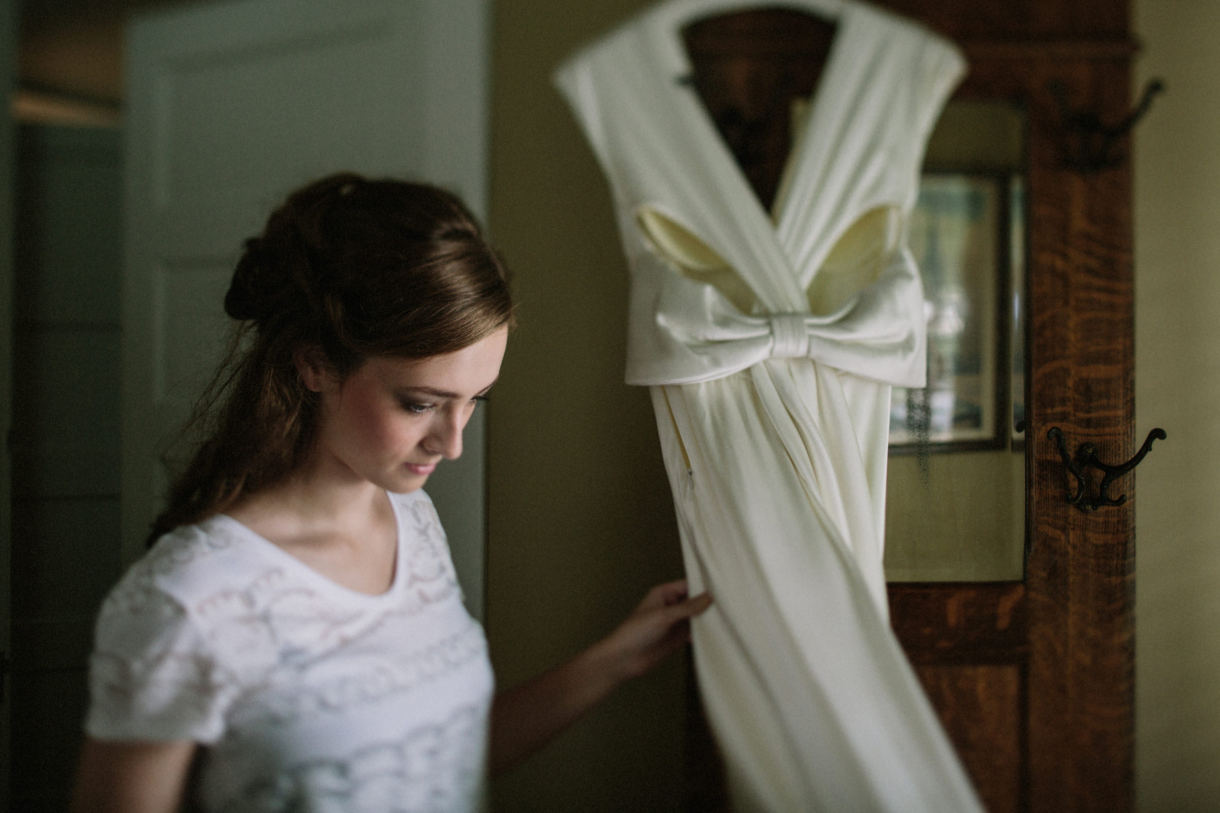 Comtemplative bride touches her wedding gown - photo by Jonas Seaman - Seattle photographer